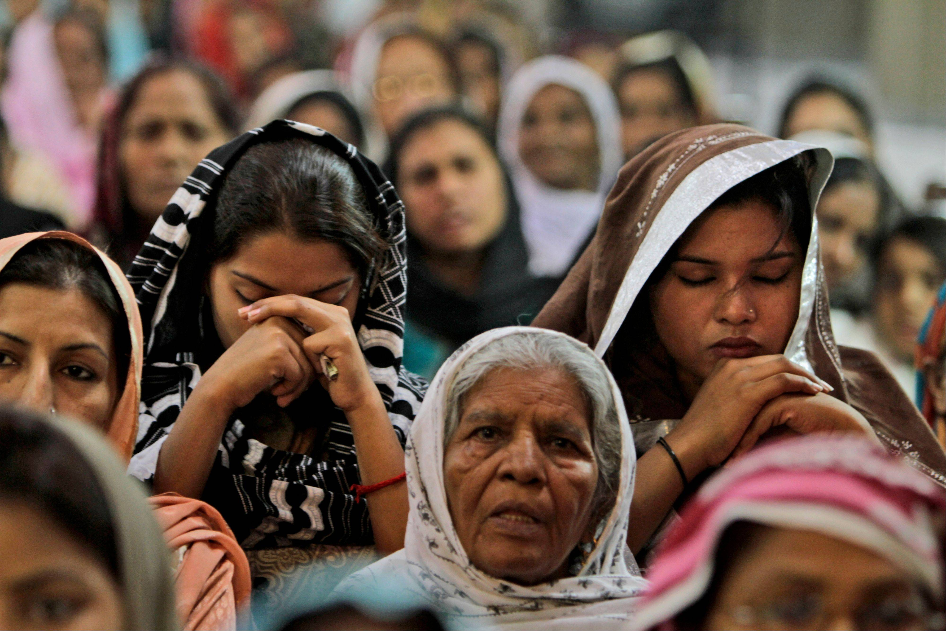 Pakistani Christians pray for the recovery of 14-year-old schoolgirl Malala Yousufzai, who was shot last Tuesday by a Taliban gunman for speaking out in support of education for women, at the Sacred Heart Cathedral Church in Lahore, Pakistan, Sunday.