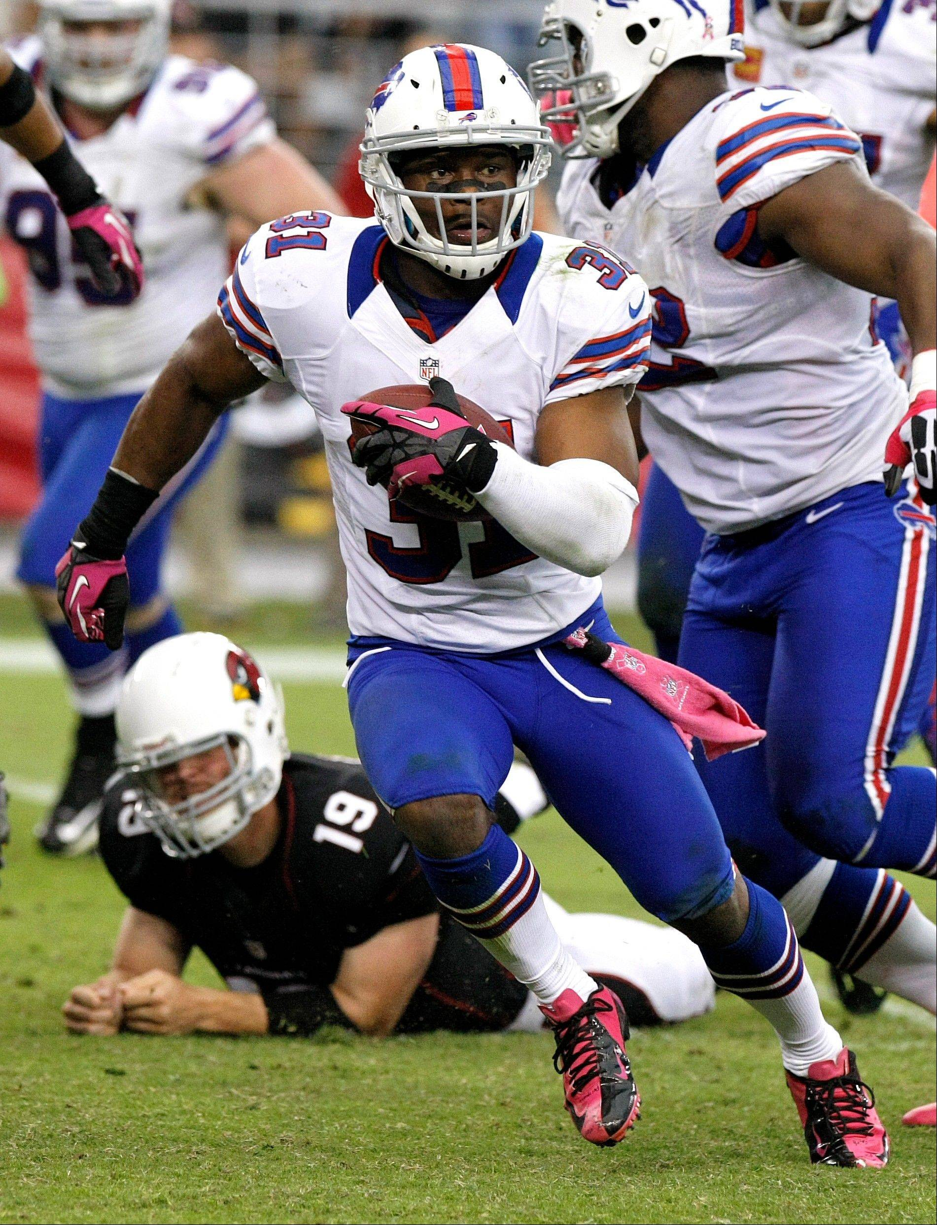 Buffalo Bills free safety Jairus Byrd (31) runs back an interception to set up the game-winning field goal against the Arizona Cardinals during the second half Sunday in Glendale, Ariz. The Bills won 19-16 in overtime.