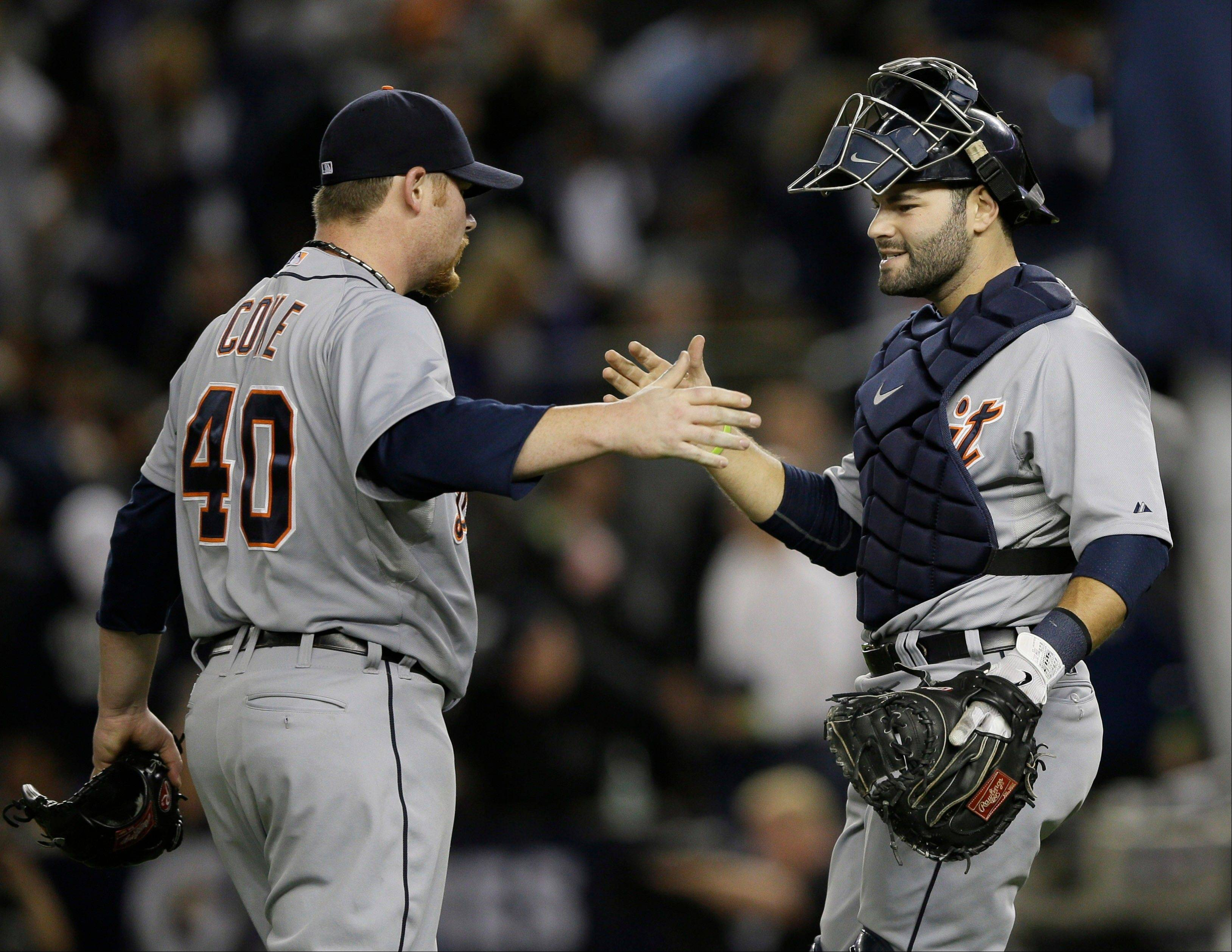 Detroit Tigers' Phil Coke, left, and Alex Avila celebrate after beating the New York Yankees 3-0 in Game 2 of the American League championship series Sunday in New York.