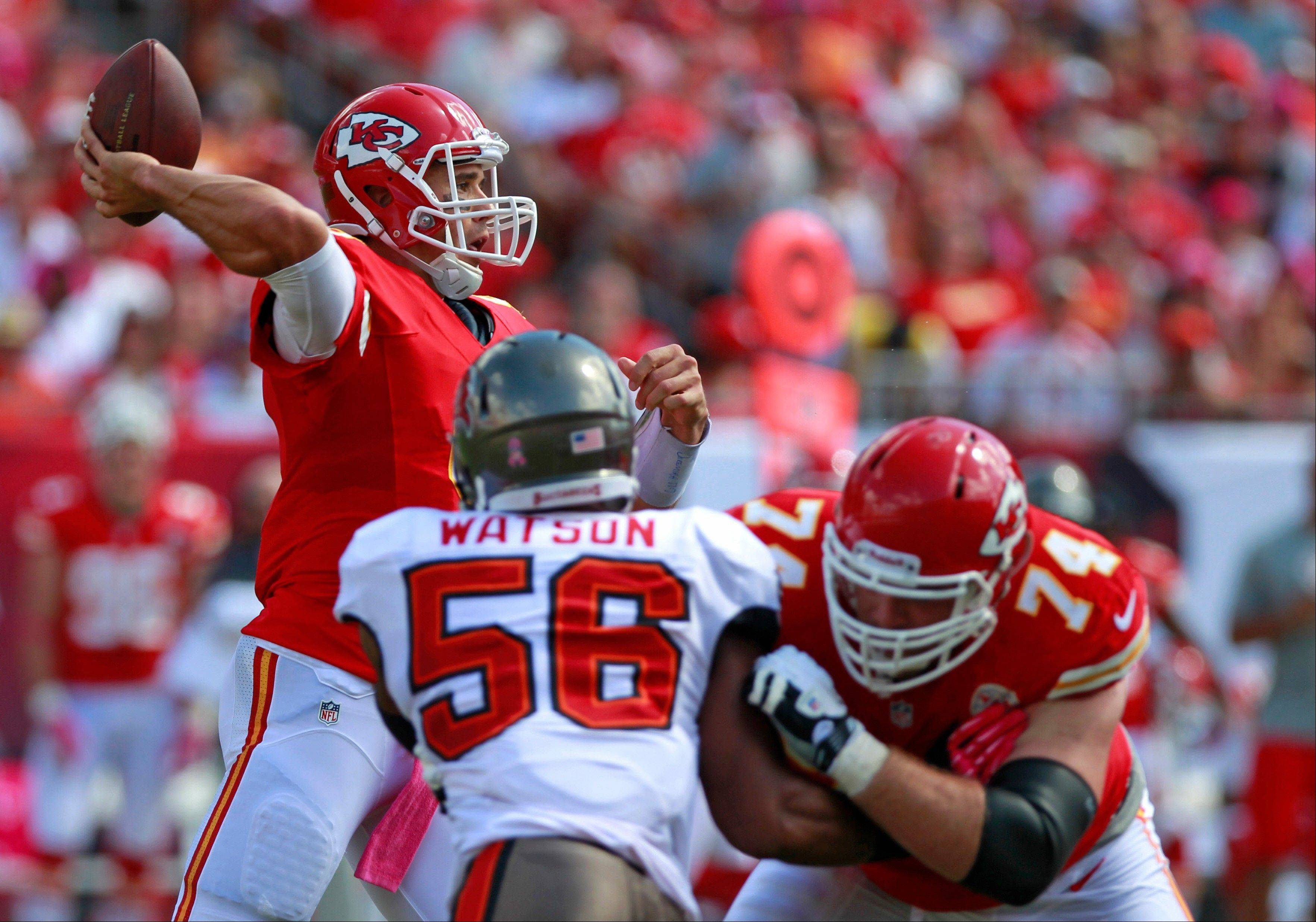 Kansas City Chiefs quarterback Brady Quinn, left, throws a pass as tackle Eric Winston (74) blocks Tampa Bay Buccaneers linebacker Dekoda Watson (56) during the first half of an NFL football game, Sunday in Tampa, Fla.