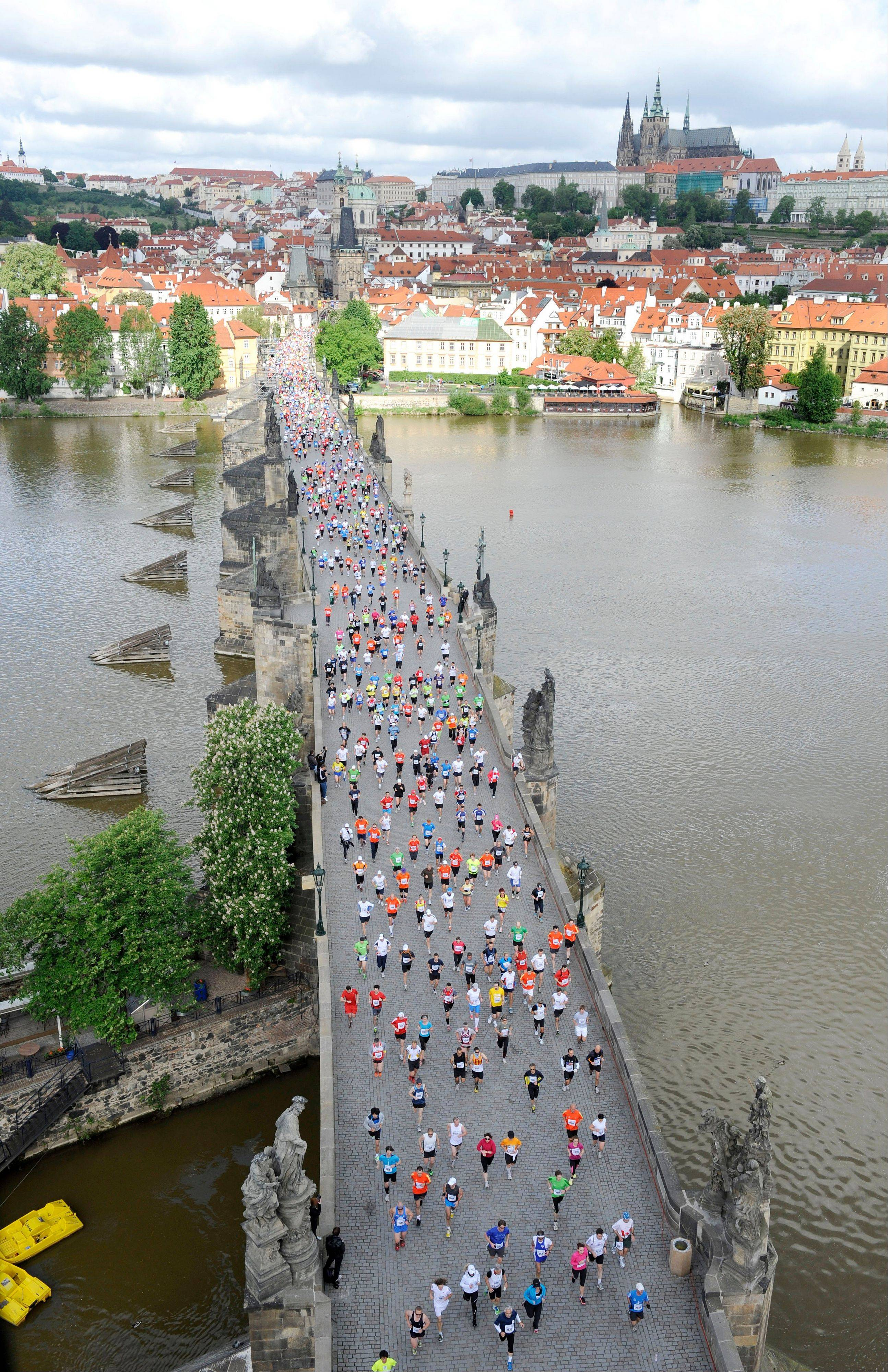 Runners cross the Charles Bridge during the Prague International Marathon in Prague.