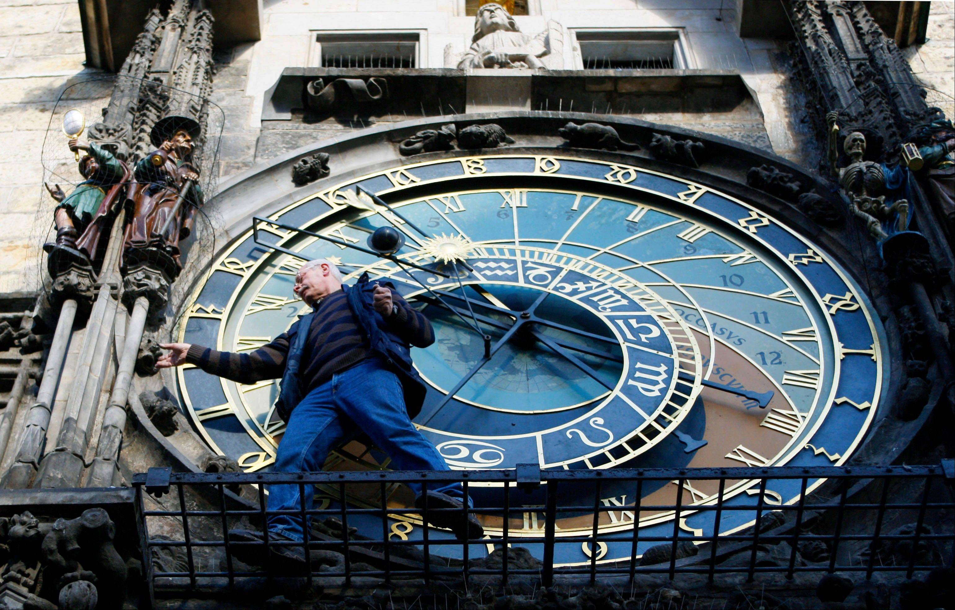 Petr Skala performs his weekly maintenance of the famous Astronomical clock at the Old Town Square.