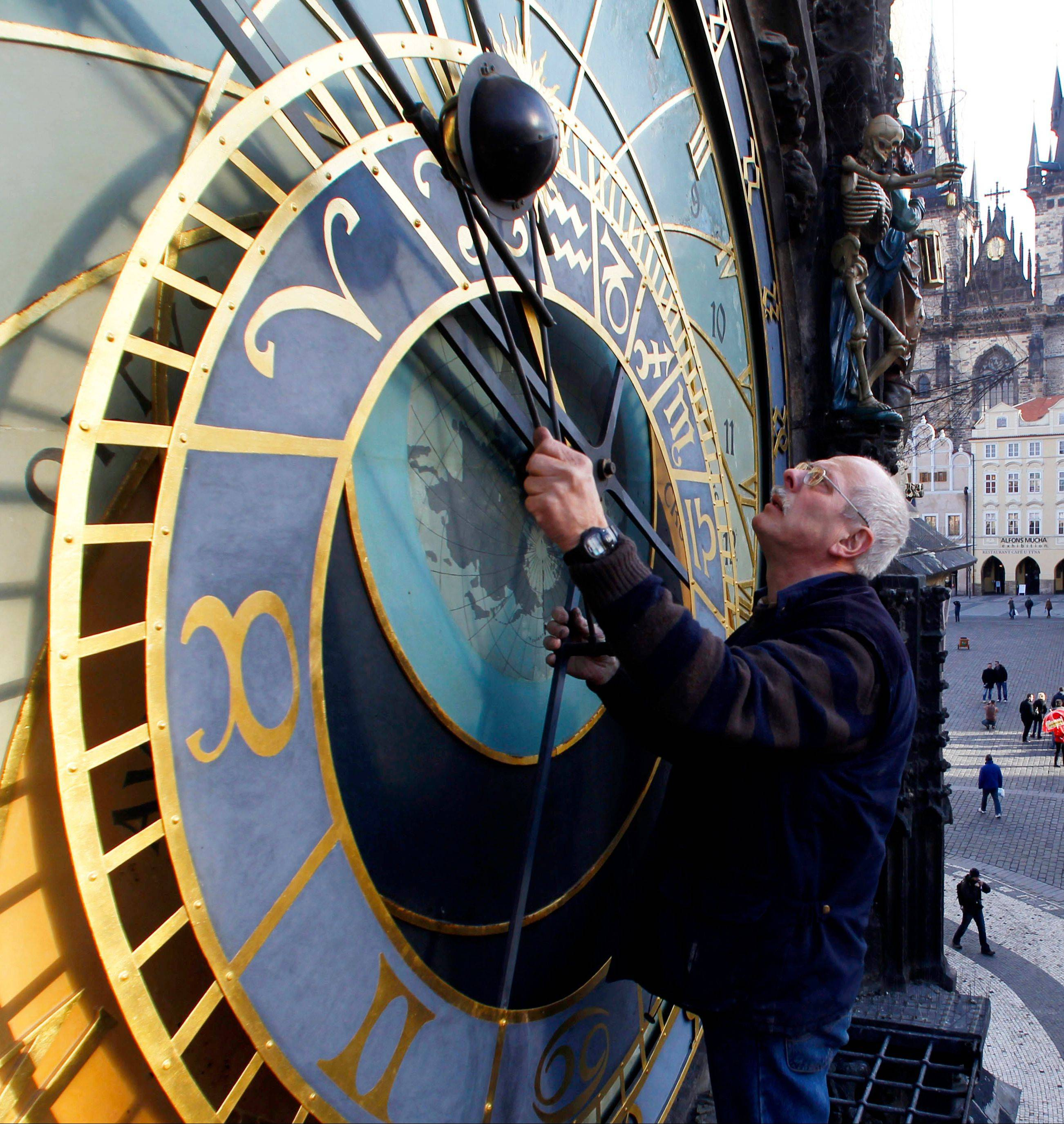 Petr Skala works on the Astronomical clock at the Old Town Square in Prague. The clock was first installed in 1410, making it the third-oldest astronomical clock in the world.