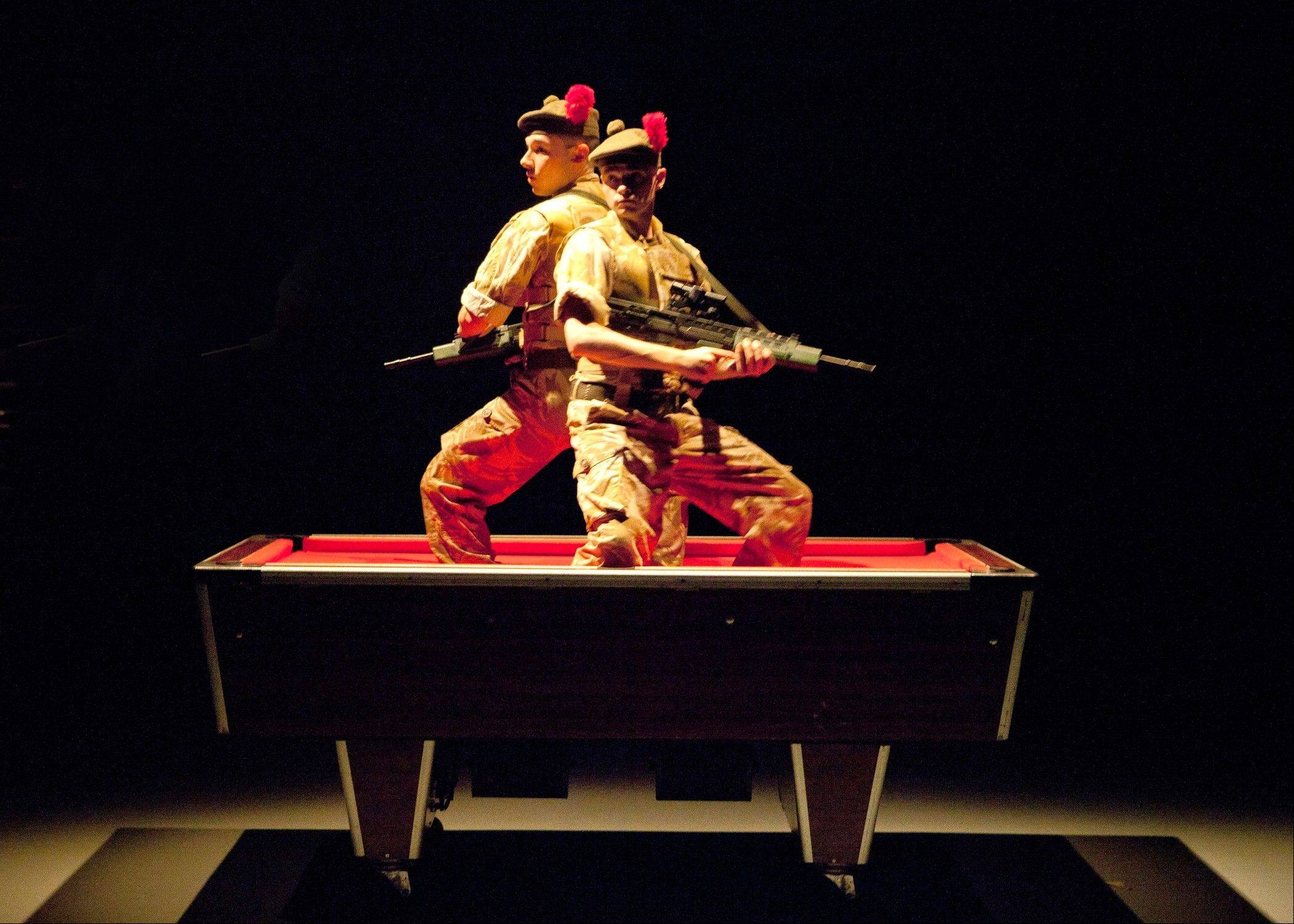 "Fraz (Andrew Fraser, left) and Kenzie (Scott Fletcher) stay vigilant during a 2004 tour in Iraq in National Theatre of Scotland's touring production of the hit show, ""Black Watch,"" which comes to Chicago as part of Chicago Shakespeare Theater's world's stage series."