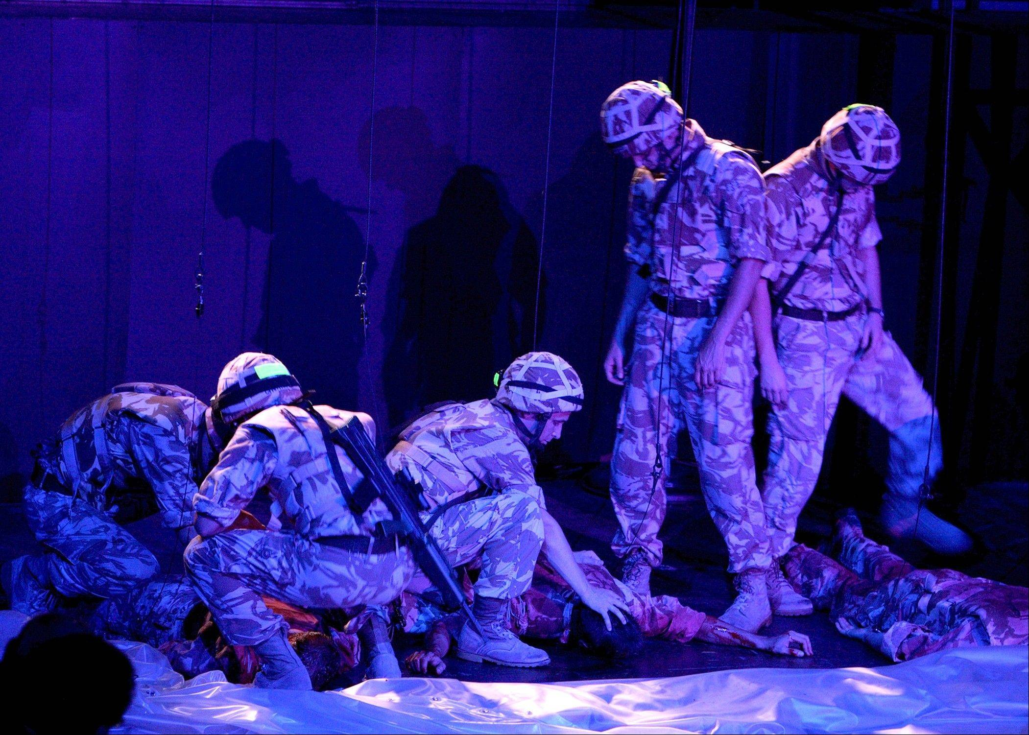 "Soldiers with Scotland's legendary Black Watch experience a devastating loss during their 2004 deployment to Iraq in the National Theatre of Scotland's riveting production, ""Black Watch."""