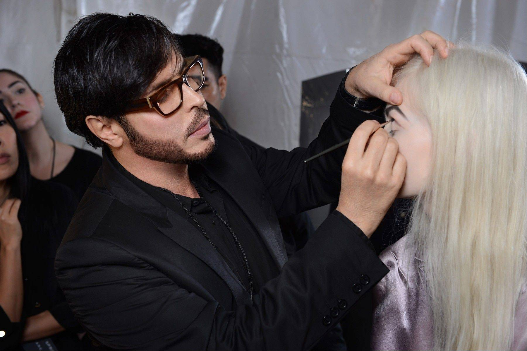 This Sept. 10, 2012 photo shows make-up artist Francois Nars, preparing a model for the Marc Jacobs Spring 2013 collection during Fashion Week in New York. Nars' company has taken on Andy Warhol's silvery Factory, silkscreened superstars and avant-garde films in a limited-edition cosmetic collection, exclusive to Sephora stores until Nov. 1.