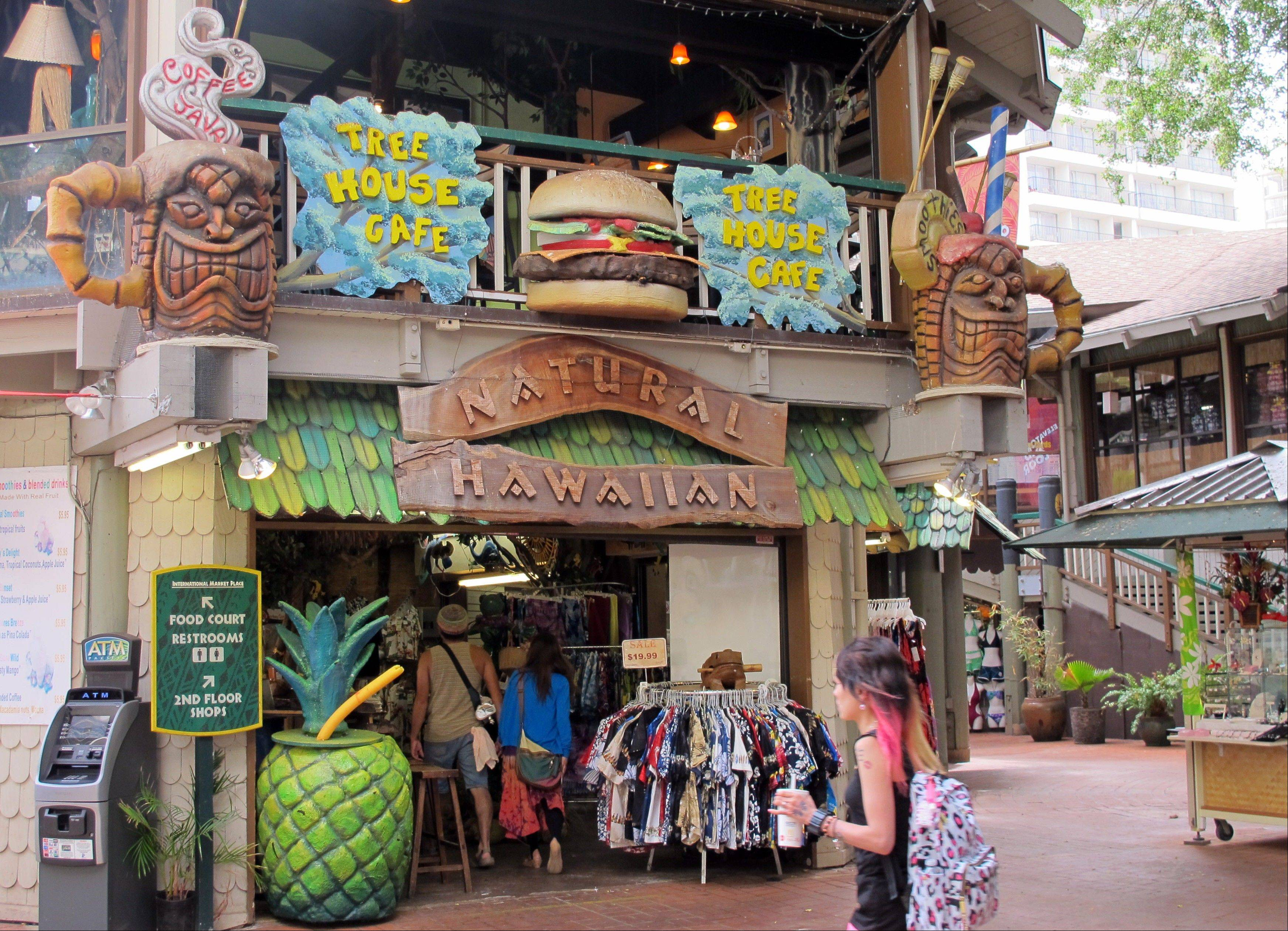 A Waikiki restaurant and store with cartoonish tiki decorations in seen in Honolulu.
