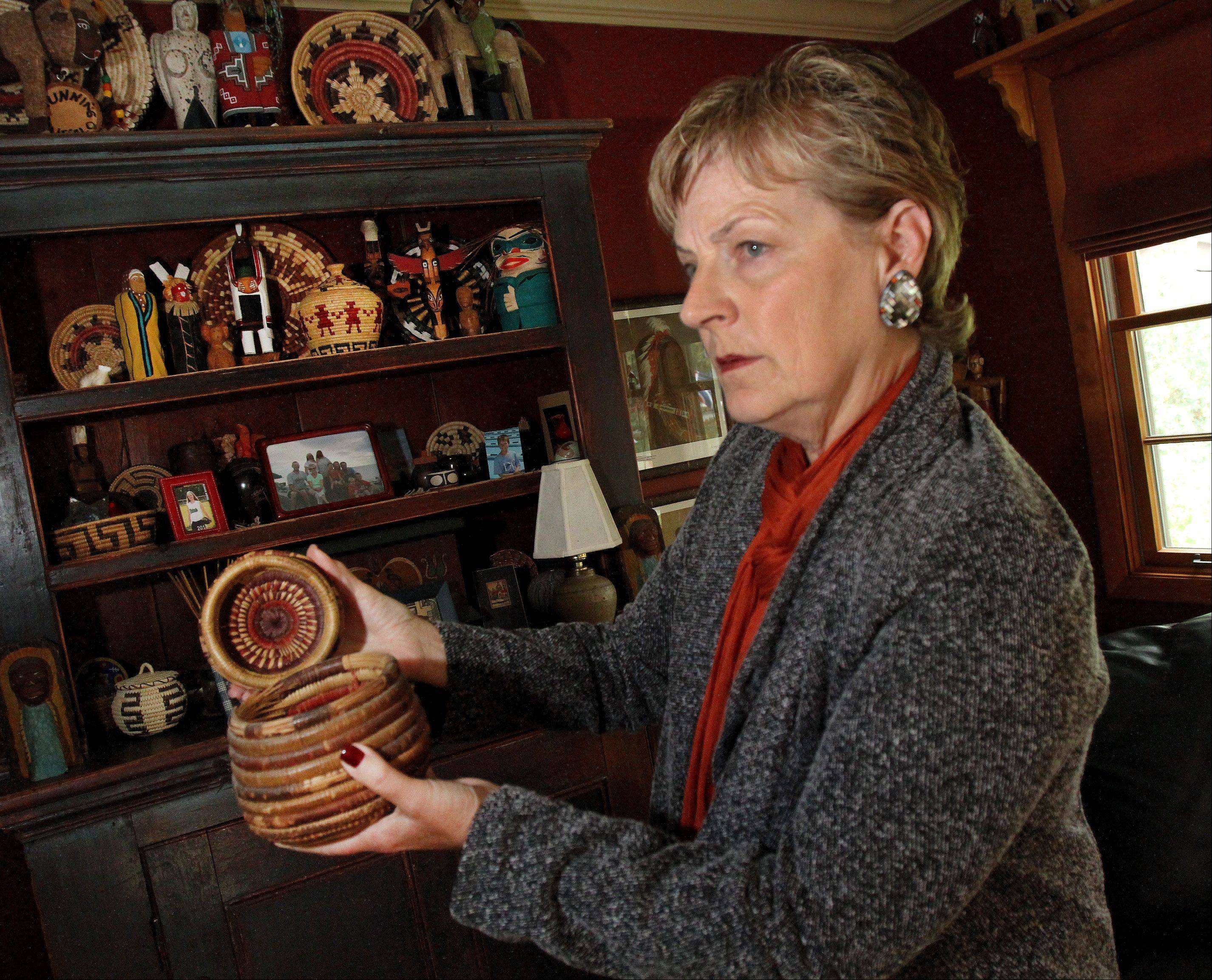 Antiques collector Linda Buehrer of Downers Grove holds a Hopi seed basket she bought at a previous Fox Valley Antiques Show. The next running of the Fall Fox Valley Antiques Show will be Oct. 20 and 21 at the Kane County Fairgrounds in St. Charles.
