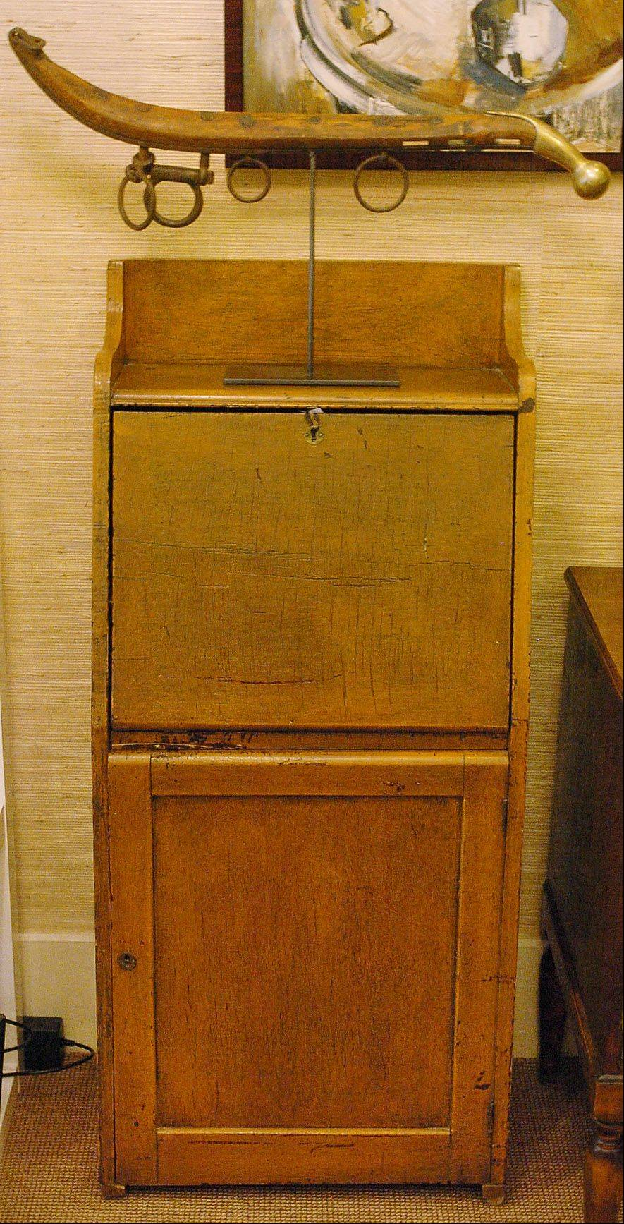 This vintage early American telephone cabinet was picked from Indiana in designer Missie Bender's shop in Glencoe called Vignette Home. Bender says she likes items with a history and sense of place.
