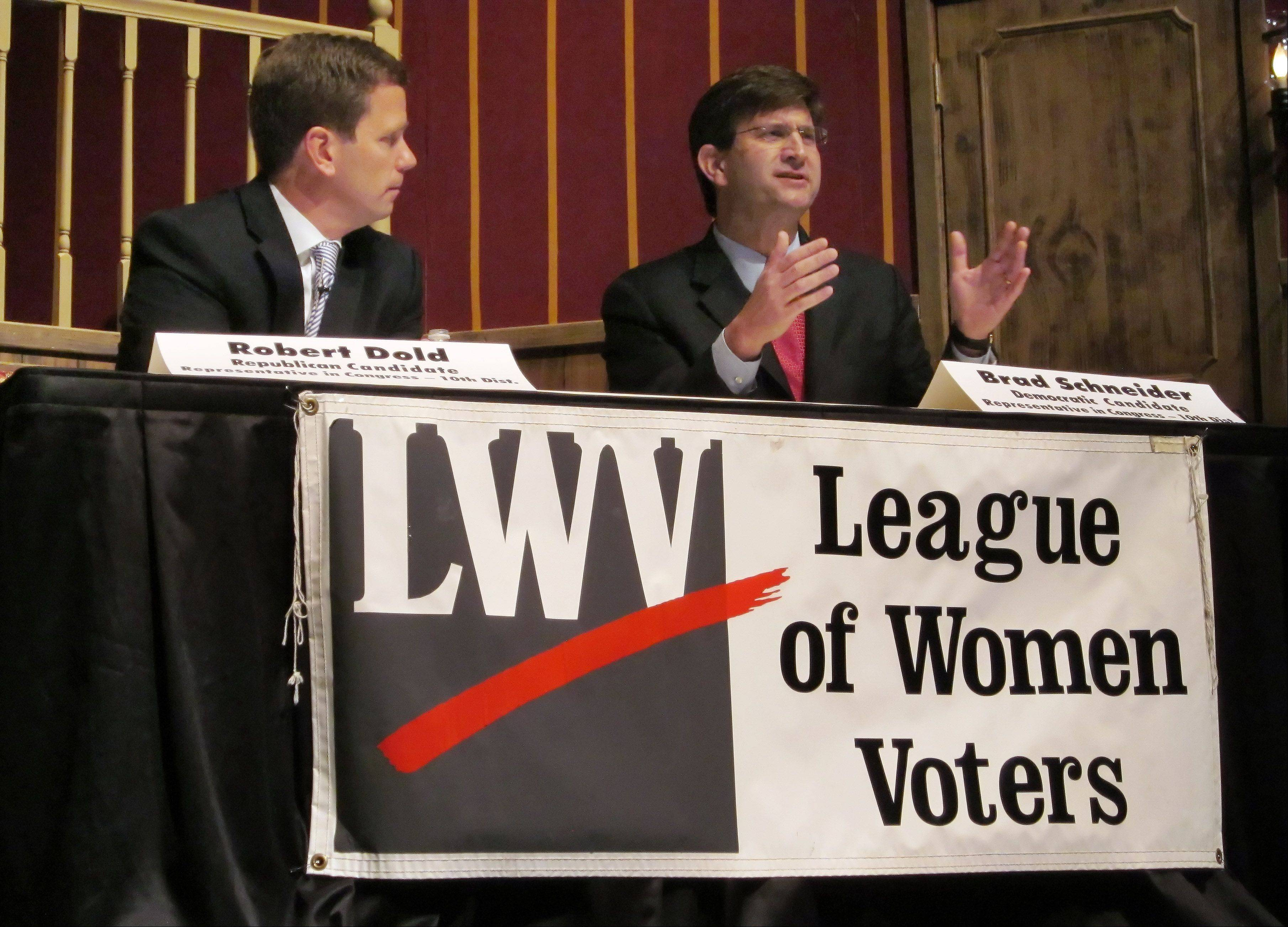 Candidates for the 10th Congressional district, incumbent Republican Robert Dold, left, and Democratic challenger Brad Schneider, right, debated Sunday at Lake Forest High School in a forum organized by three chapters of the League of Women Voters.