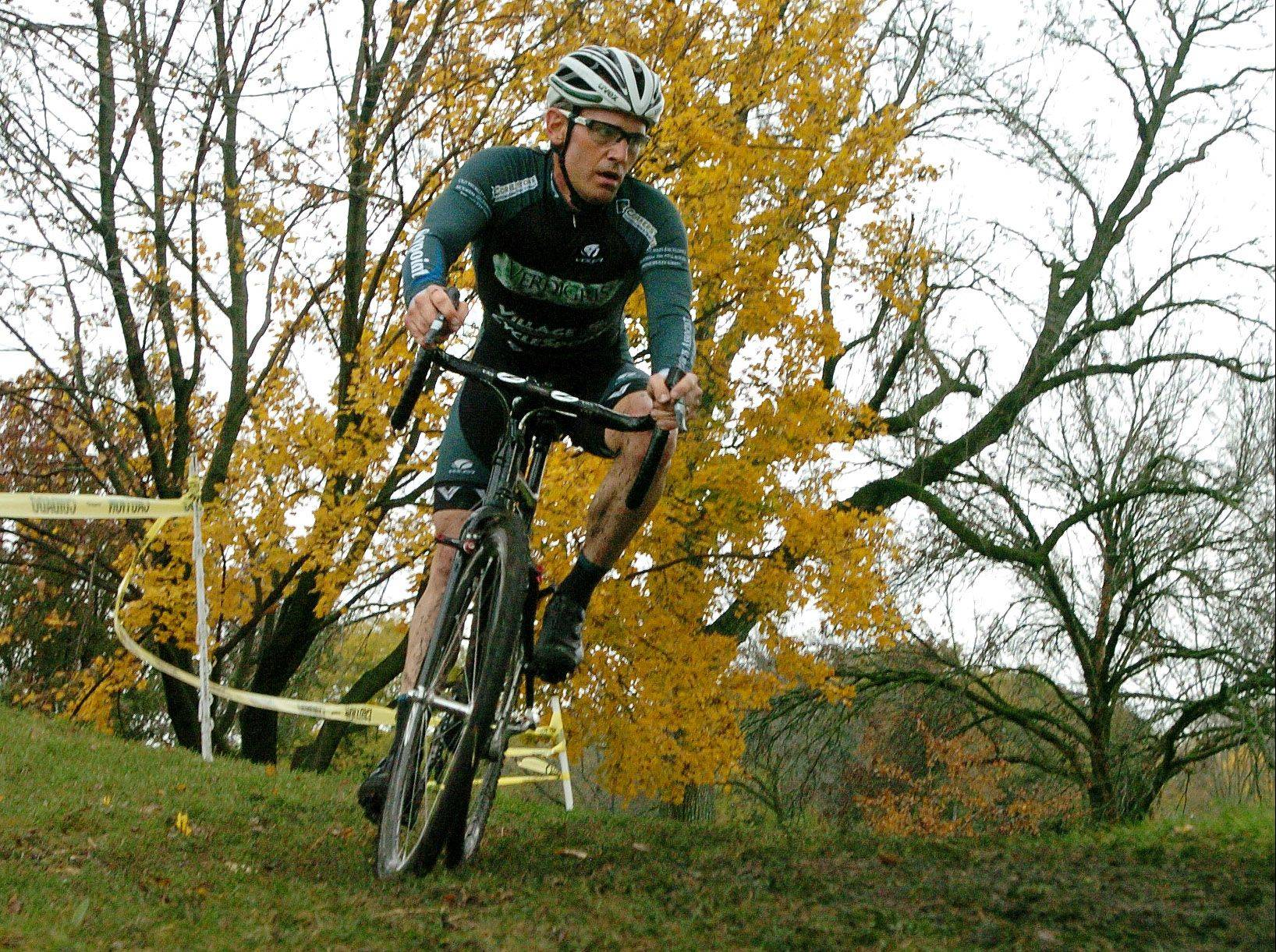 Tim Boundy of Deer Park, rides toward the finish line in the Carpentersville Cyclocross bicycle event Sunday at Oktoberfest. Boundy finished first in the age 30-plus group.