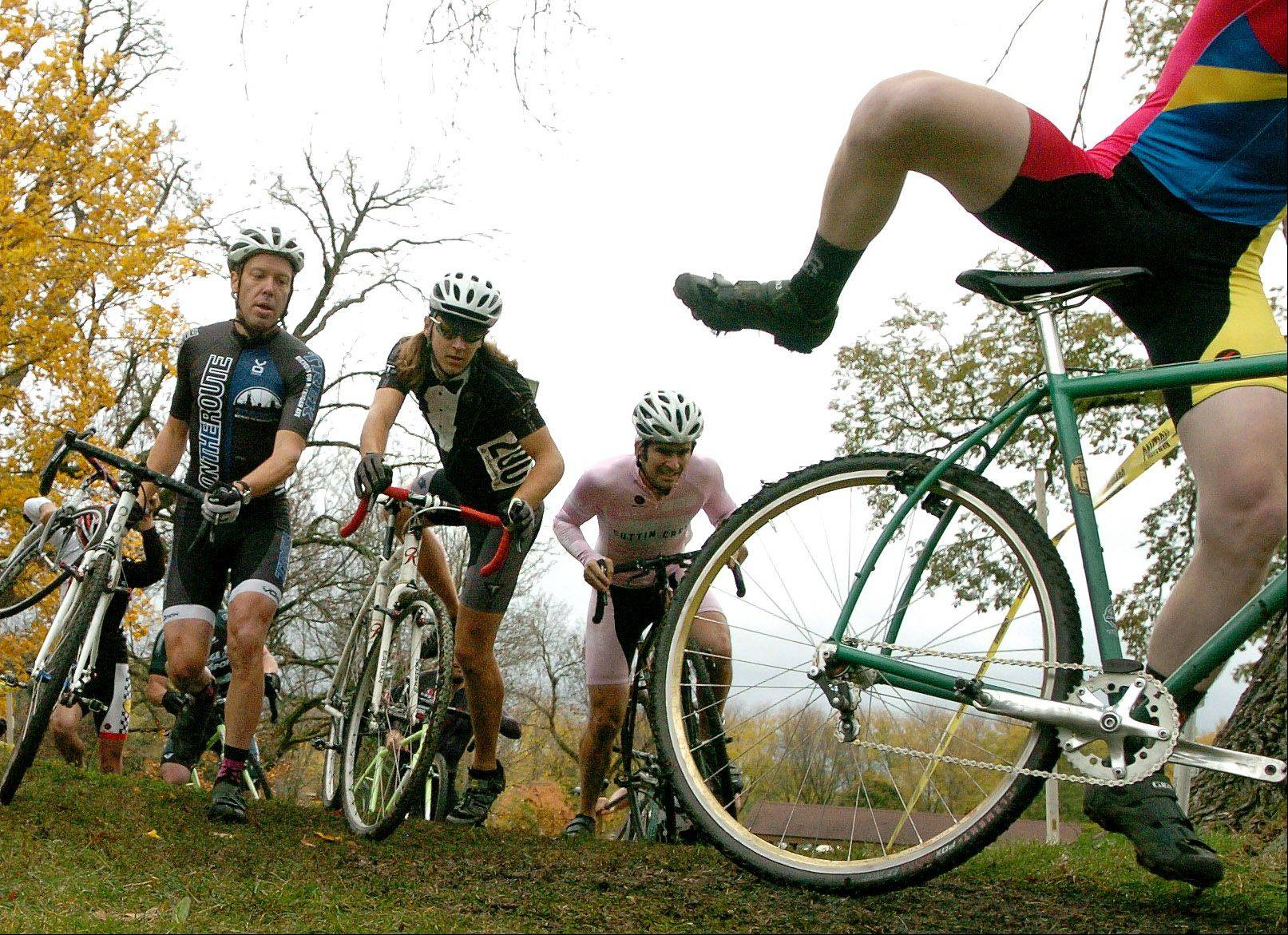 Riders make their way up a hill during the single speed bike race at the Carpentersville Cyclocross bicycle event Sunday during Oktoberfest.