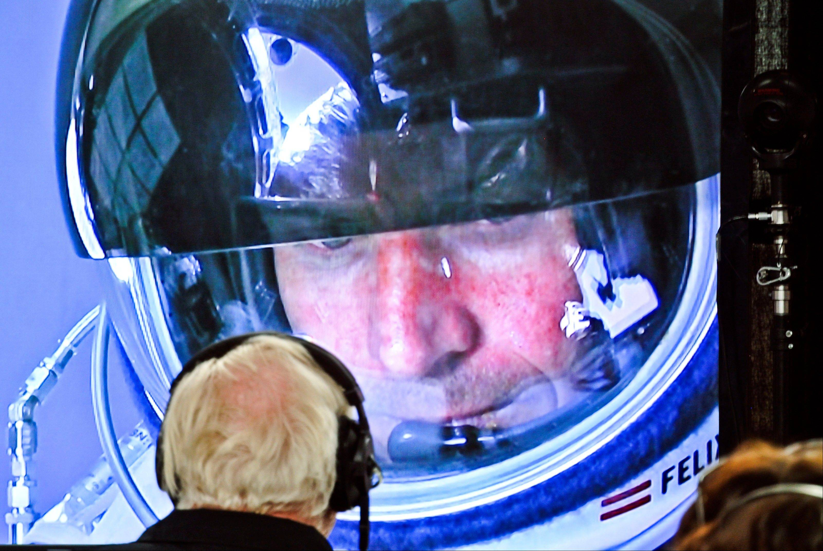 In this photo provided by Red Bull, pilot Felix Baumgartner of Austria is seen in a screen at mission control center in the capsule during the final manned flight for Red Bull Stratos in Roswell, N.M. on Sunday, Oct. 14, 2012. Baumgartner plans to jump from an altitude of 120,000 feet, an altitude chosen to enable him to achieve Mach 1 in free fall, which would deliver scientific data to the aerospace community about human survival from high altitudes.