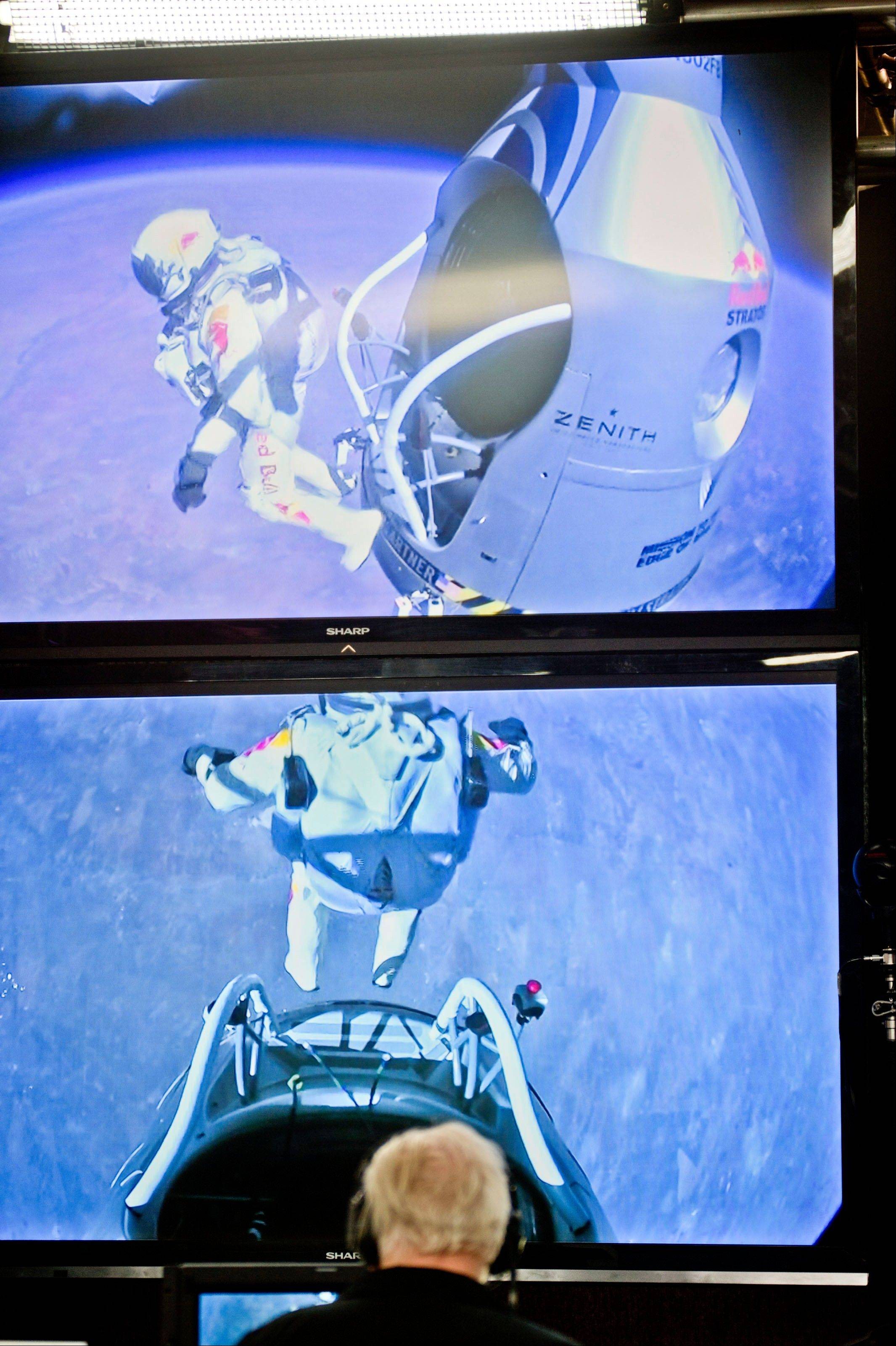 In this photo provided by Red Bull, Pilot Felix Baumgartner of Austria jumps out from the capsule during the final manned flight for Red Bull Stratos in Roswell, N.M., Sunday, Oct. 14, 2012.�Baumgartner came down safely in the eastern New Mexico desert minutes about nine minutes after jumping from his capsule 128,097 feet, or roughly 24 miles, above Earth.