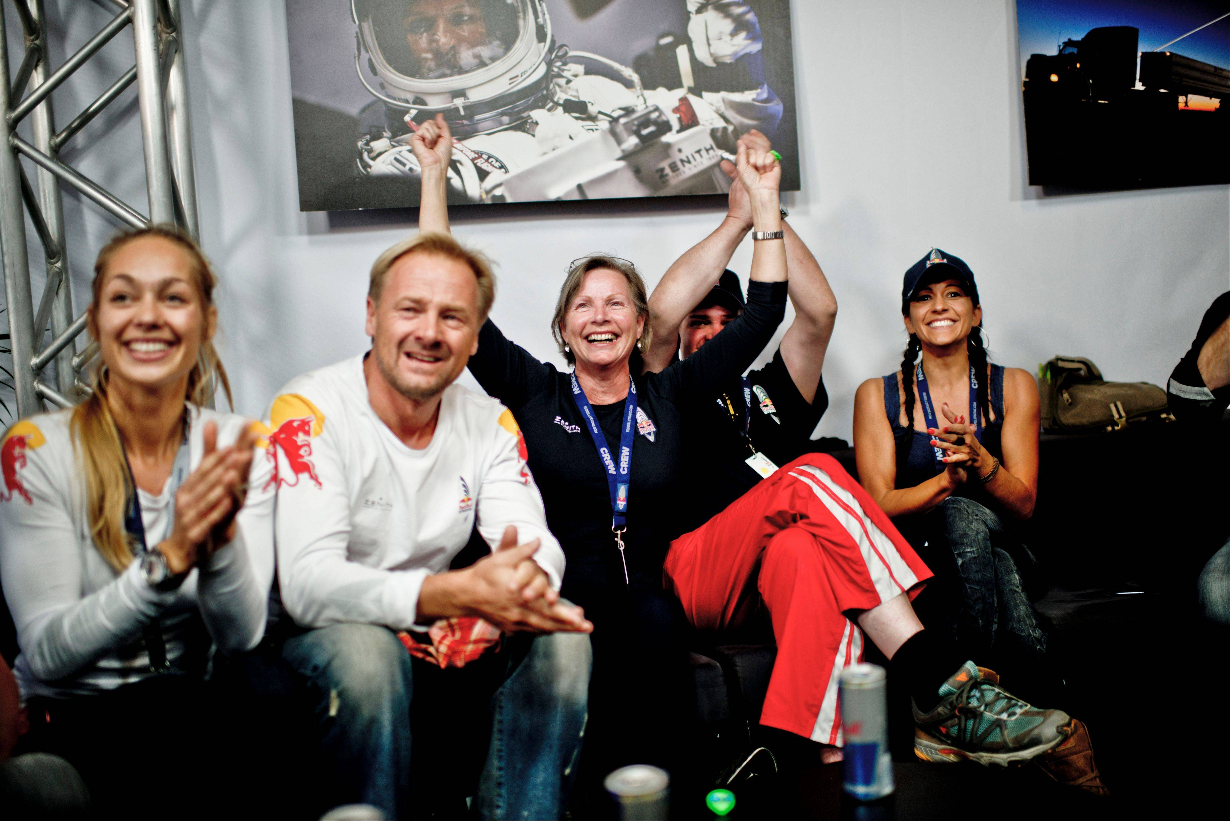 In this photo provided by Red Bull, family members and friends, celebrate the successful jump of pilot Felix Baumgartner of Austria in Roswell, N.M. on Sunday, Oct. 14, 2012. Baumgartner came down safely in the eastern New Mexico desert minutes about nine minutes after jumping from his capsule 128,097 feet, or roughly 24 miles, above Earth.