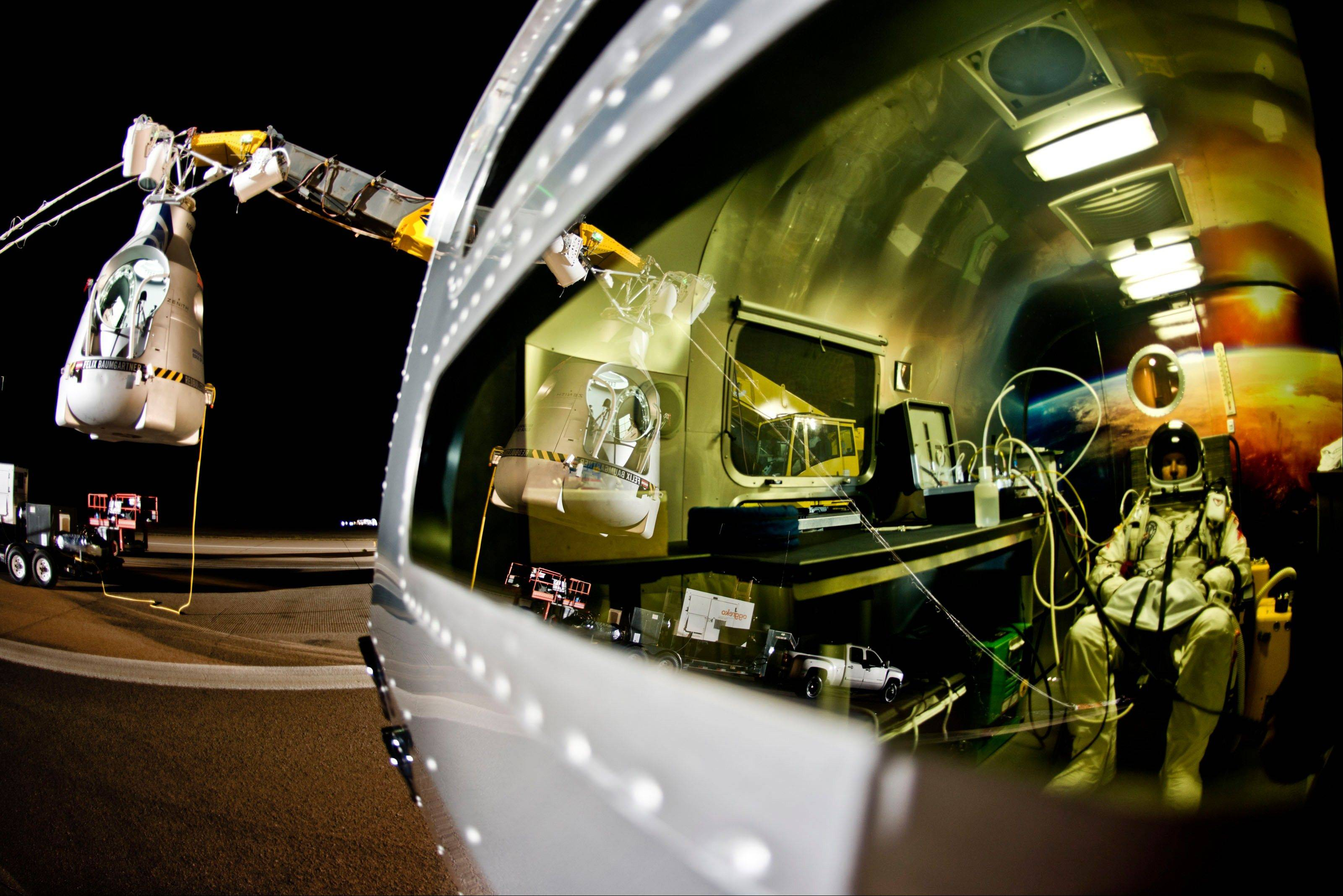 In this photo provided by Red Bull, pilot Felix Baumgartner of Austria sits in his trailer during the final manned flight for Red Bull Stratos in Roswell, N.M. on Sunday, Oct. 14, 2012. Baumgartner plans to jump from an altitude of 120,000 feet, an altitude chosen to enable him to achieve Mach 1 in free fall, which would deliver scientific data to the aerospace community about human survival from high altitudes.