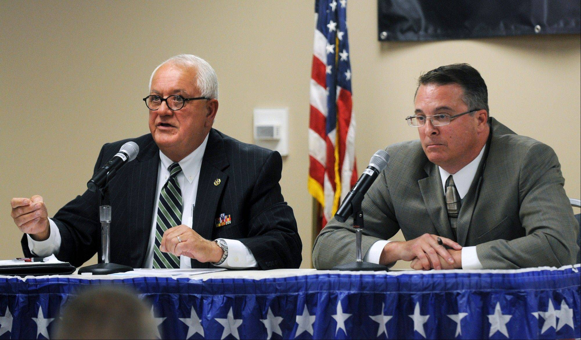 Republican Bill Albracht and Democratic incumbent Mike Jacobs, candidates in the 36th state Senate District, answer questions during a recent forum at Black Hawk College in Moline.