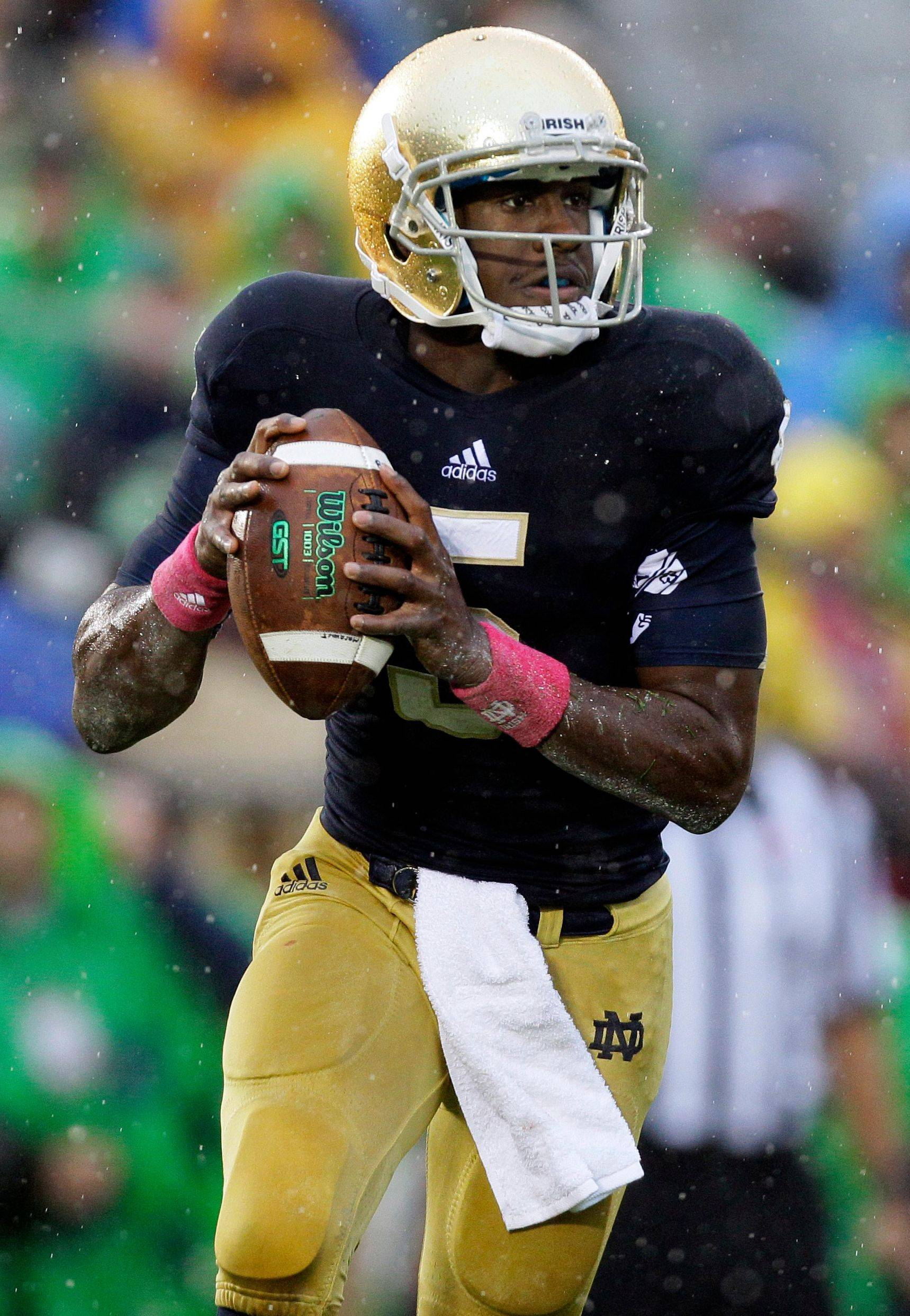 Notre Dame quarterback Everett Golson rolls out to pass during the first half of an NCAA college football game against Stanford in South Bend, Ind., Saturday.