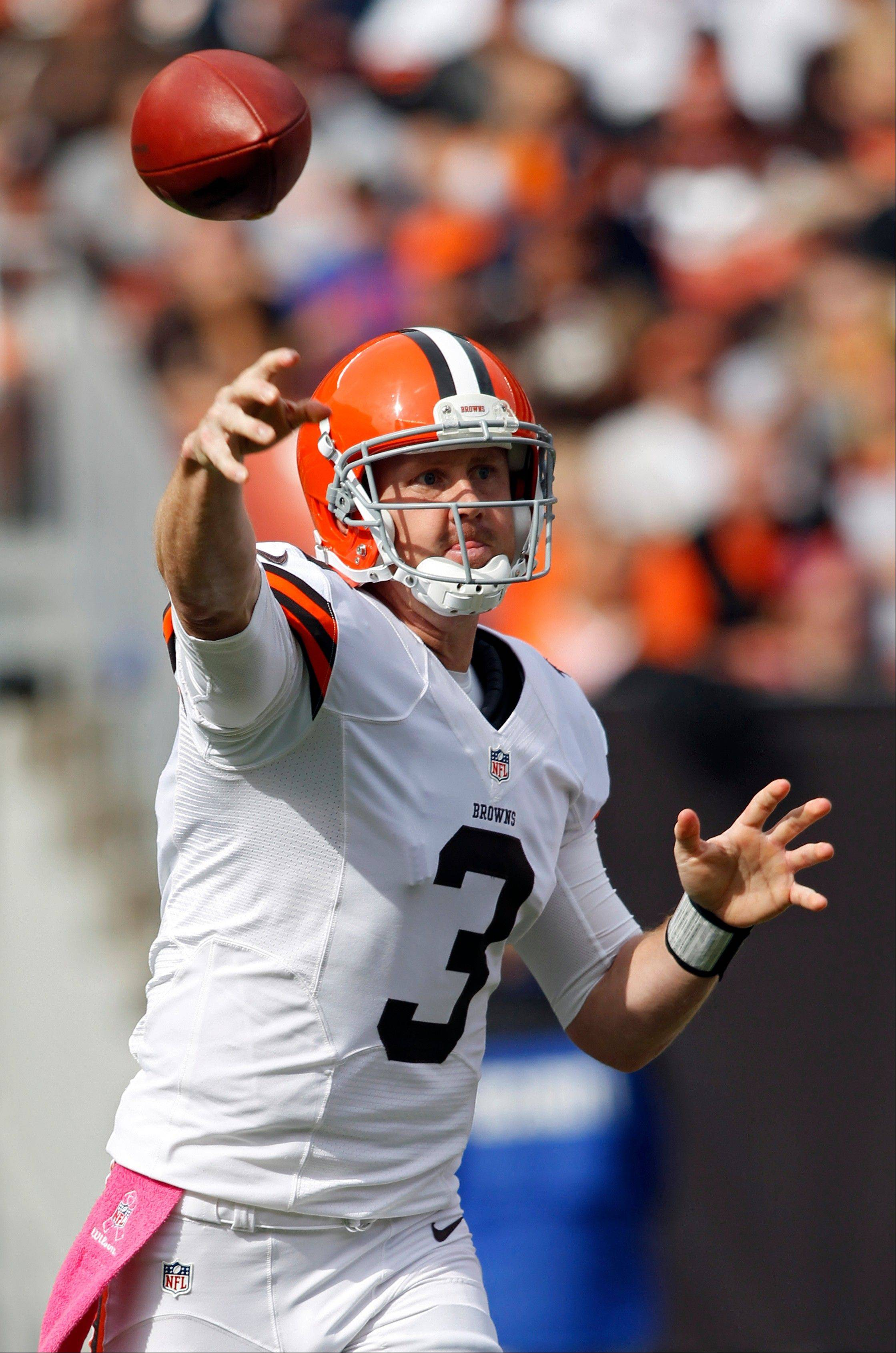 Cleveland Browns quarterback Brandon Weeden passes against the Cincinnati Bengals in the first quarter of an NFL football game on Sunday in Cleveland.
