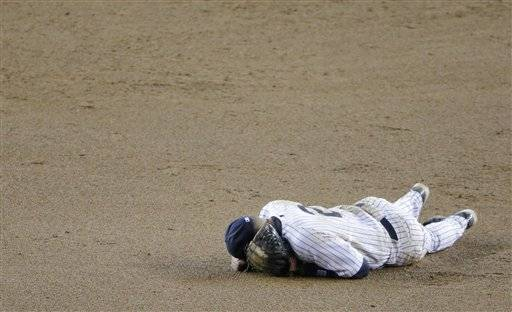 New York Yankees shortstop Derek Jeter reacts after injuring himself in the 12th inning of Game 1 of the American League championship series against the Detroit Tigers early Sunday, Oct. 14, 2012, in New York.