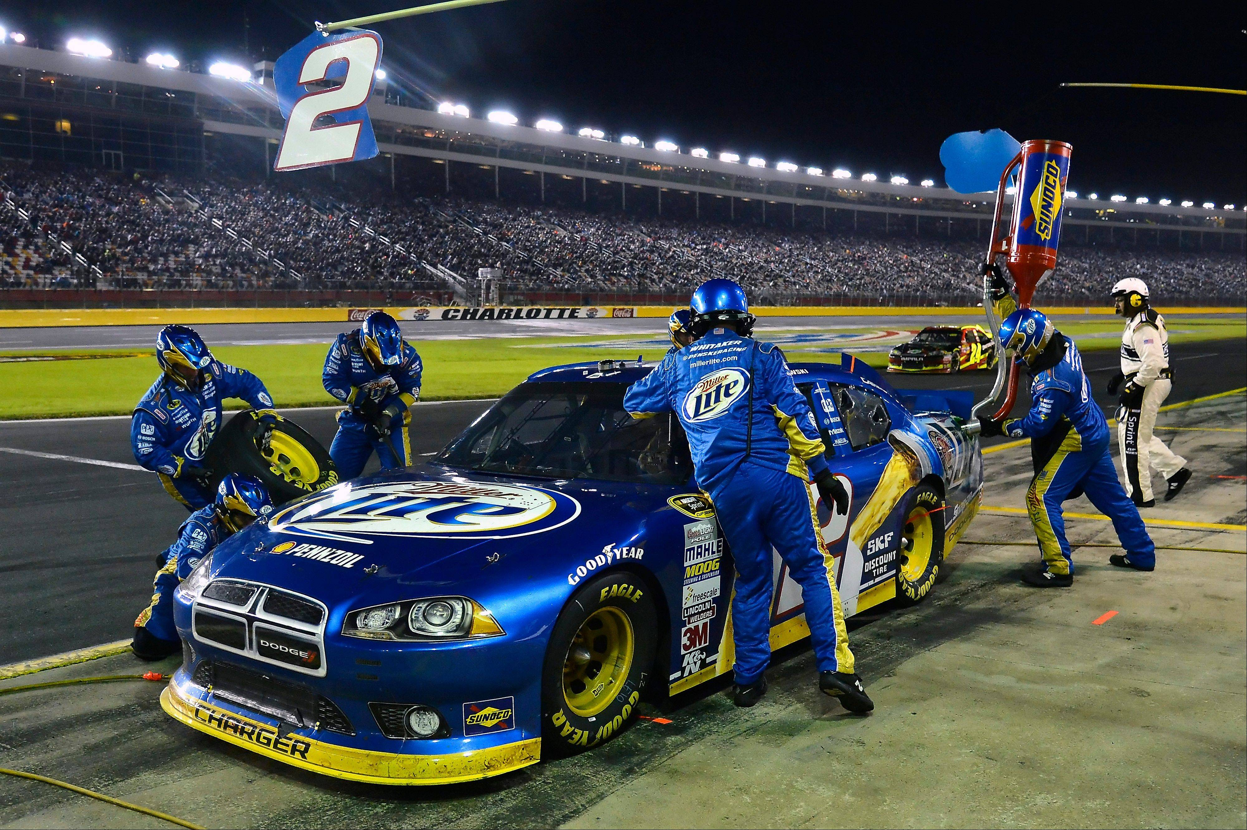 Brad Keselowski makes a pitstop during the NASCAR Sprint Cup Series auto race at Charlotte Motor Speedway Saturday in Concord, N.C.