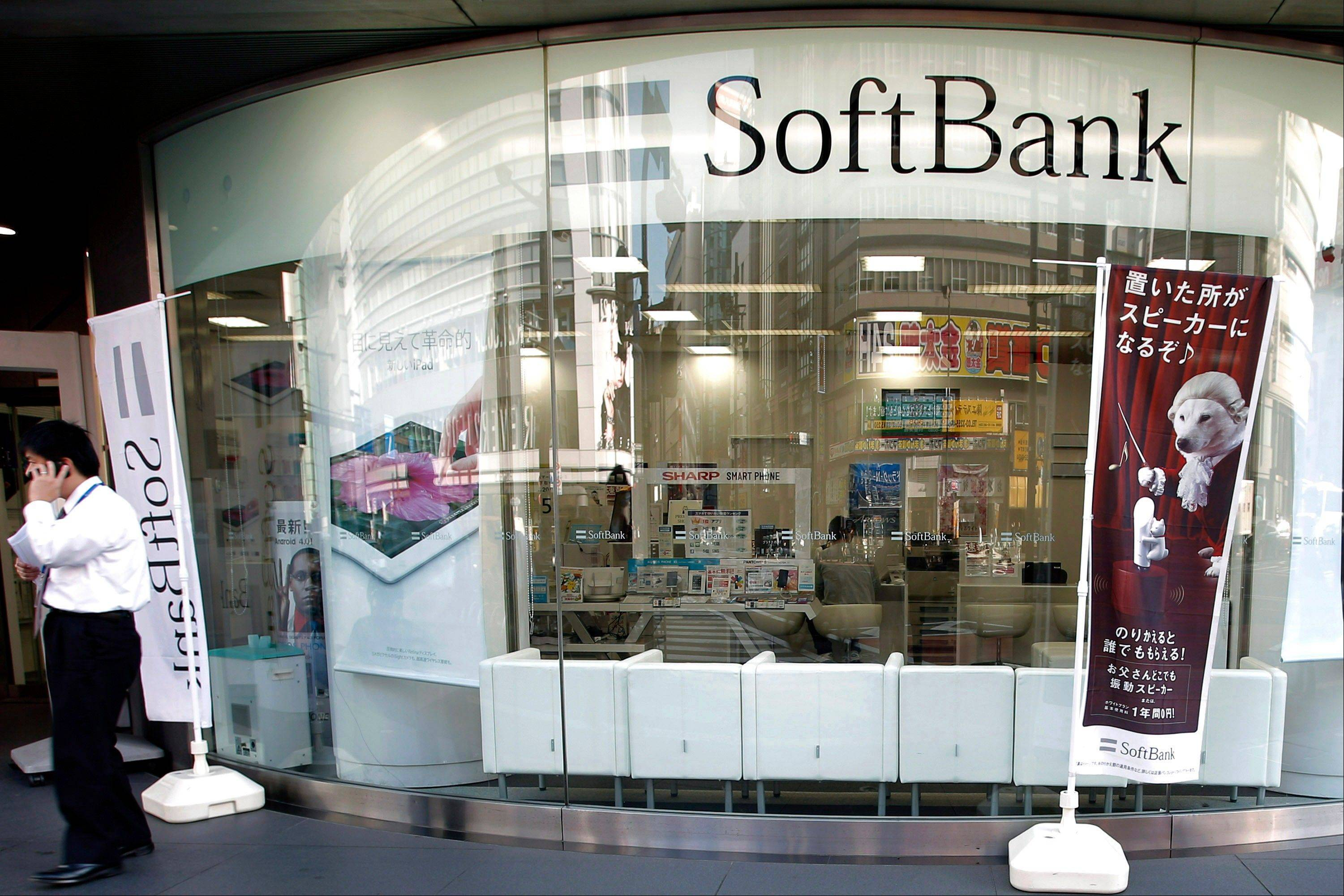 A man uses his mobile phone outside a Softbank Corp. store in Tokyo, Japan.