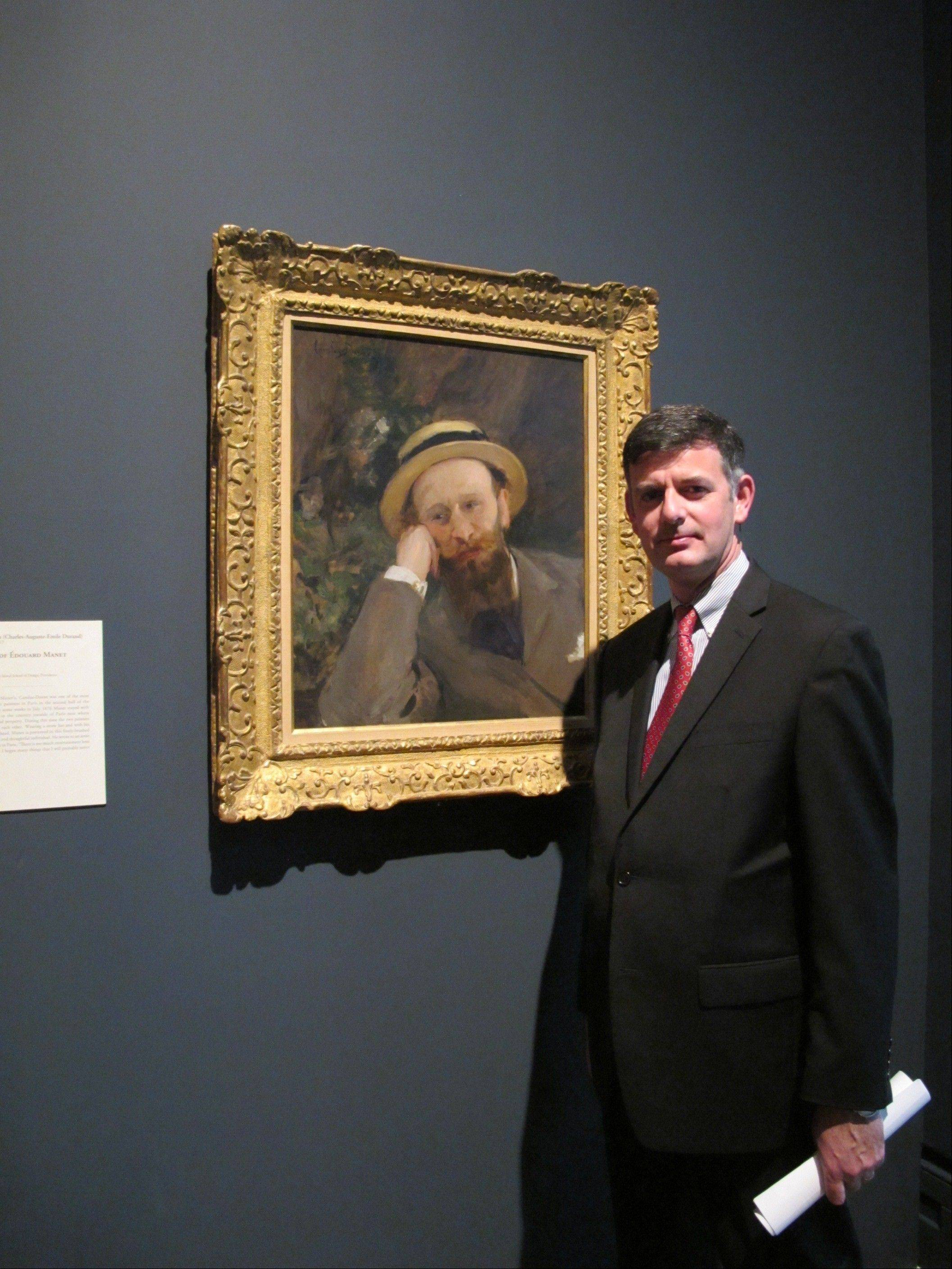 Associated PressBrian Kennedy, director of the Toledo Museum of Art, in front of a portrait of French Impressionist Edouard Manet.