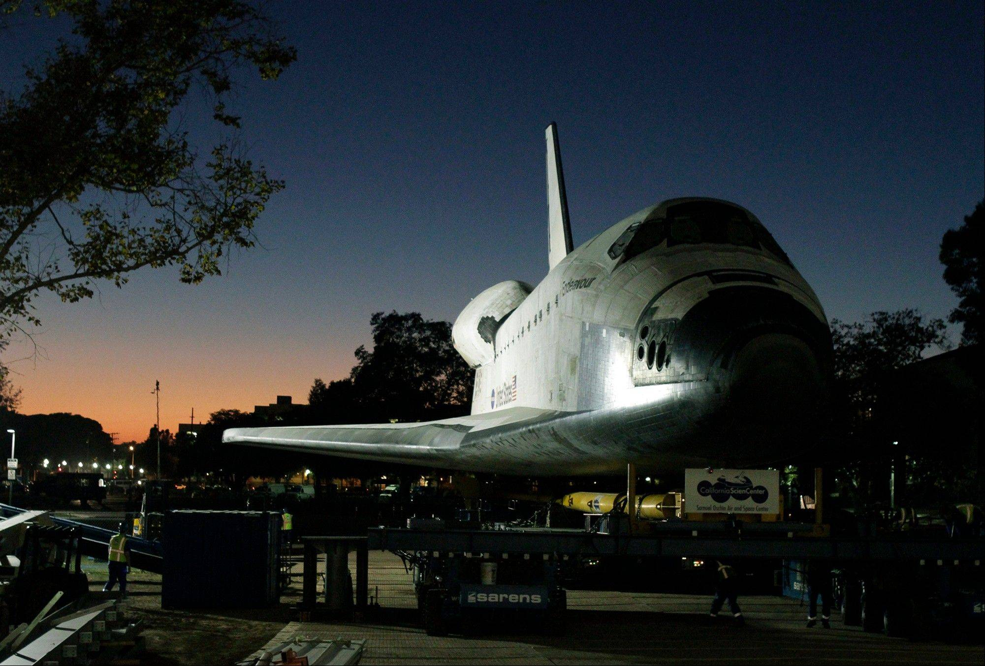 The space shuttle Endeavour is moved to the hangar in the California Science Center for its last stop on Sunday, Oct. 14, 2012, in Los Angeles.