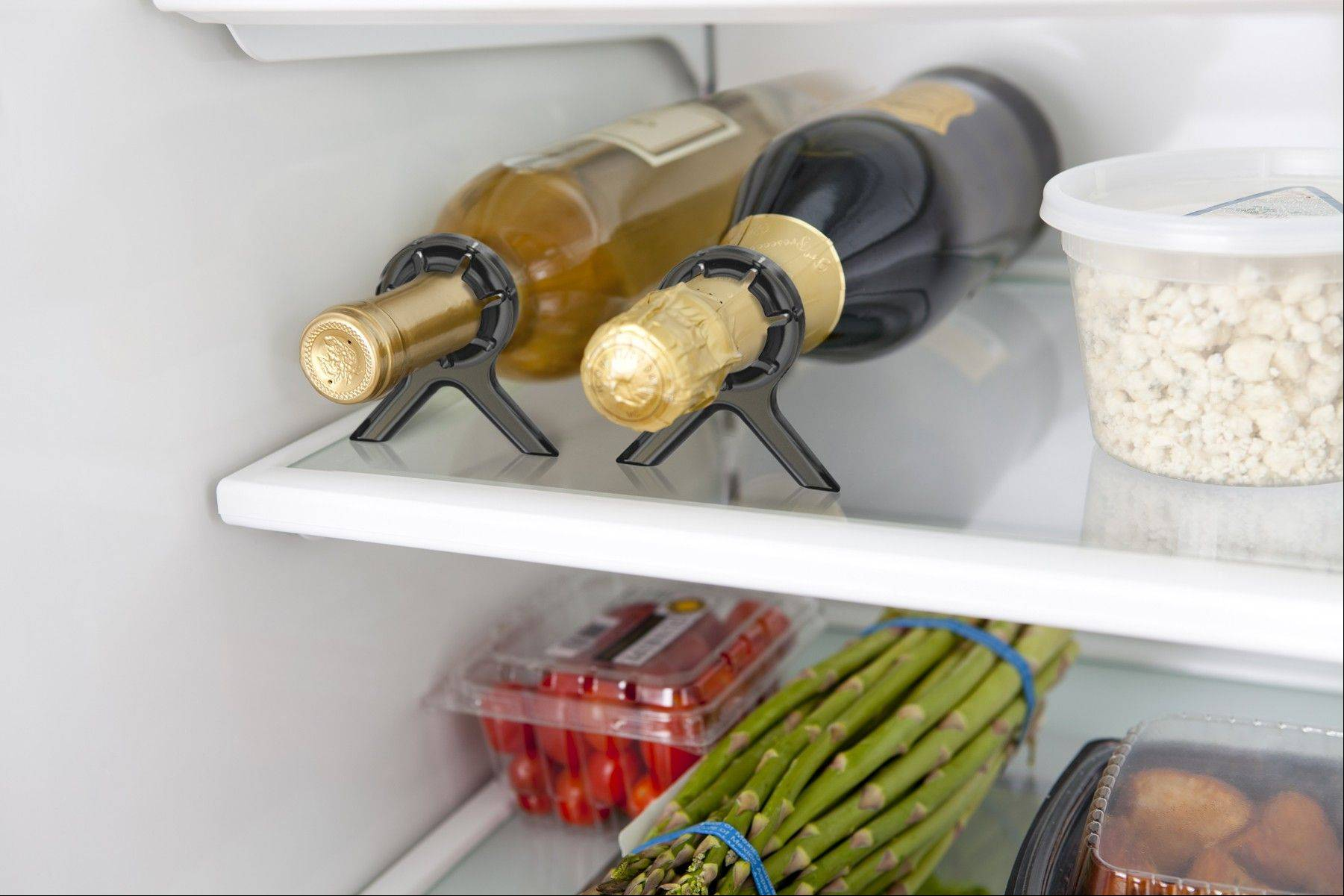 Stop those bottles of wine from rolling around in the fridge with the Vine, a device that keeps the bottles in place and invented by Marc Rumaner of Aurora.