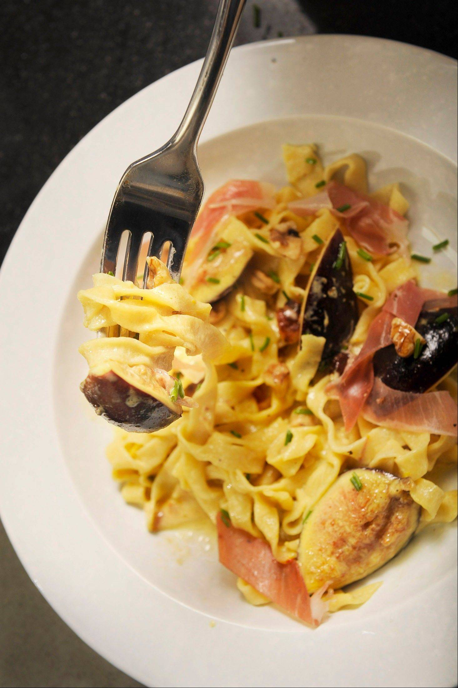 Hand-cranked saffron fettuccine partners with figs and a creamy cambozola sauce for a perfect fall dish.