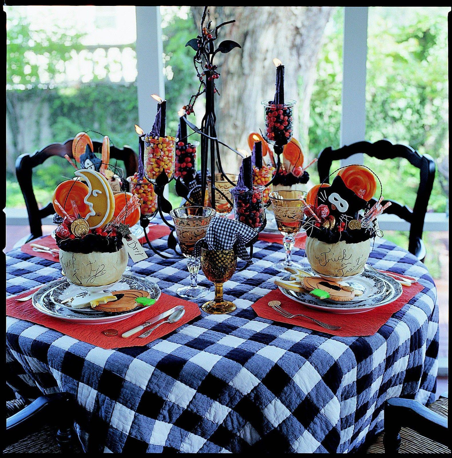 this table on the porch is set for a kidfriendly halloween party using