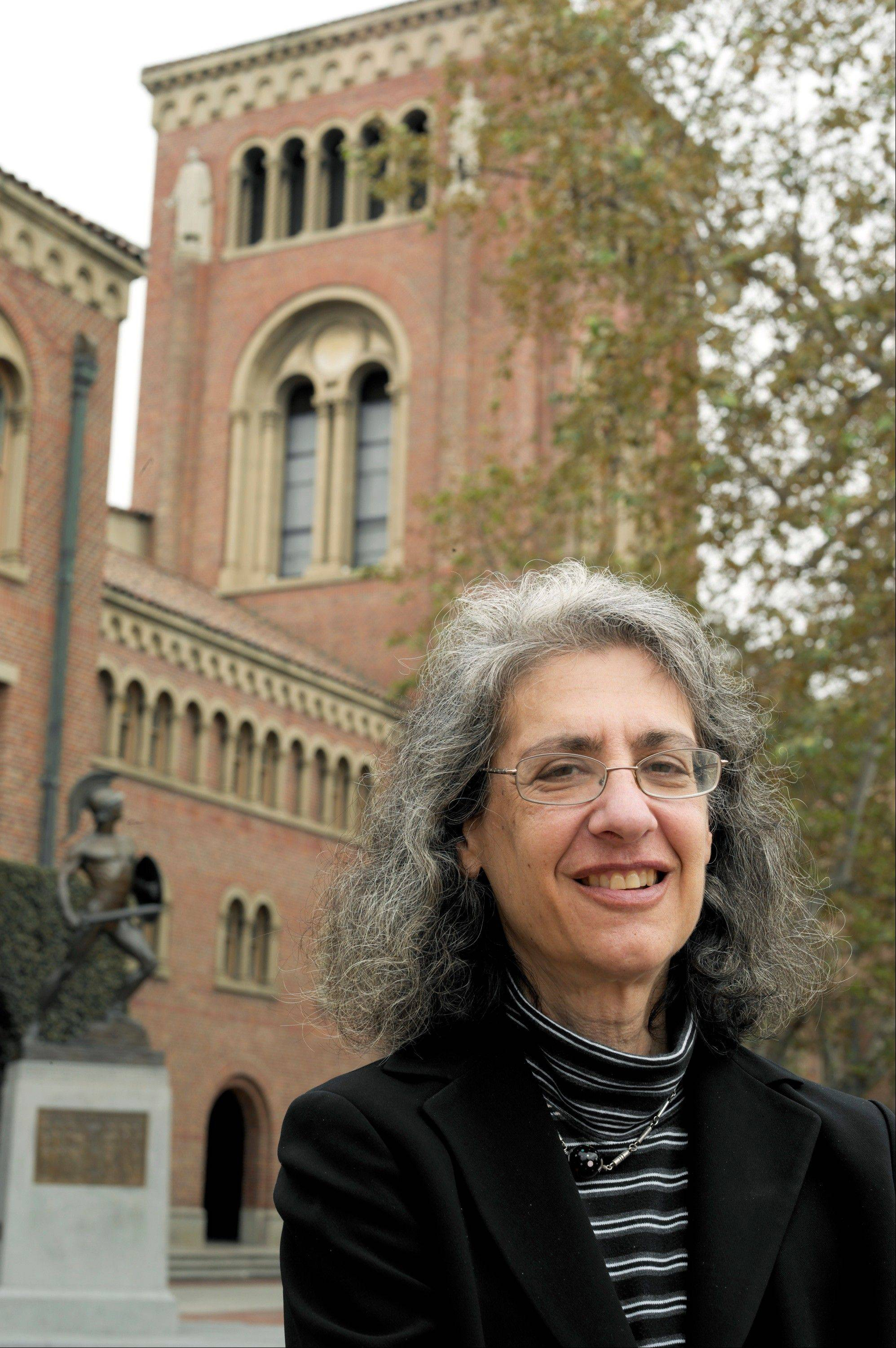 "Law professor Elyn Saks poses for a photo at the University of Southern California campus in Los Angeles. Saks, who suffers from schizophrenia, wrote a memoir, ""The Center Cannot Hold: My Journey Through Madness,"" and was a recipient of a MacArthur Foundation ""genius grant,"" for her contributions to mental health law."