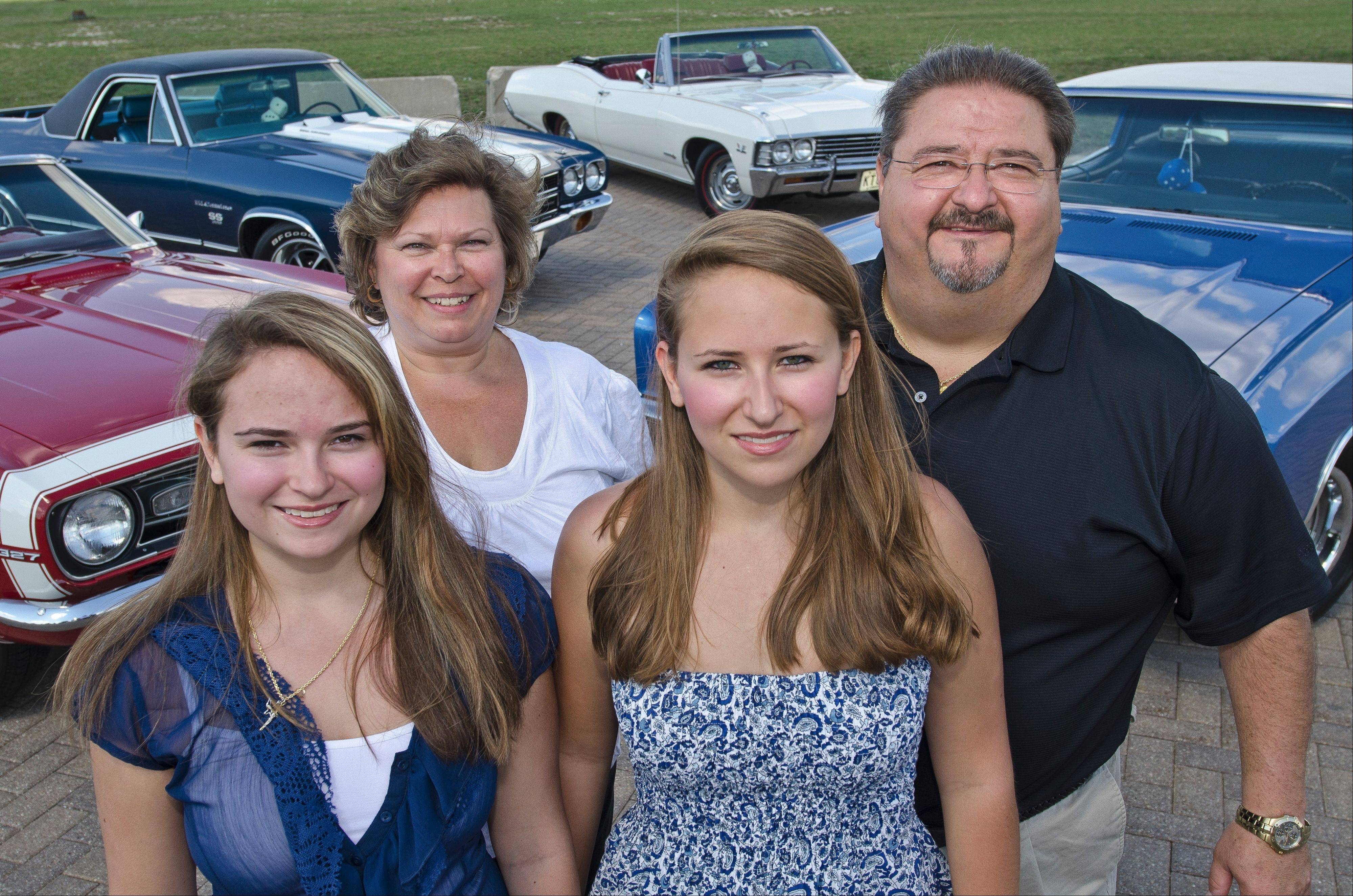 The Porzak family of Hoffman Estates shares a love of vintage Chevrolet muscle. Parents Darlene and Tom and their twin daughters Jenny, left, and Kristin drive the family Chevy collection.