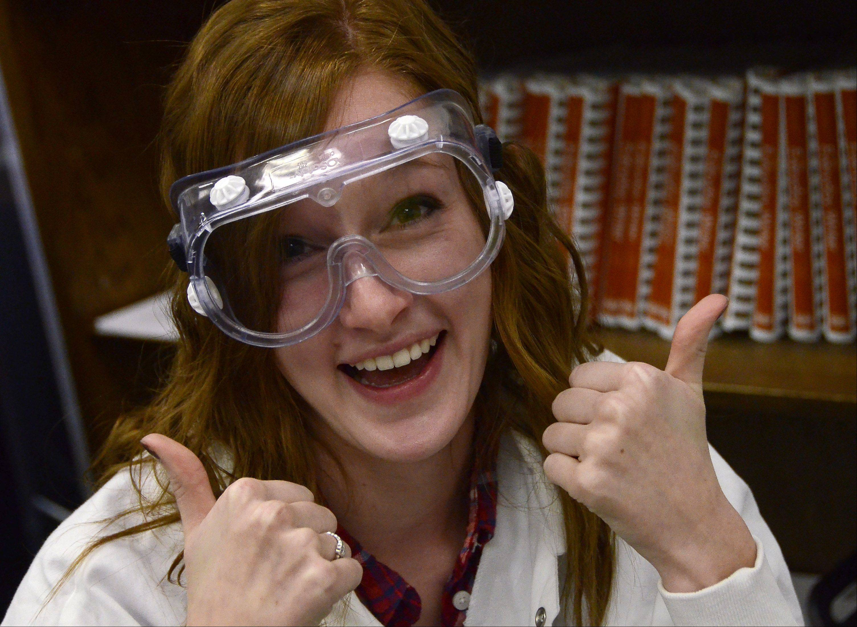 The keep things light and informal, tutors working in the Literacy Lab at Buffalo Grove High School, like Alexandra Anderson, wear goggles and lab coats.