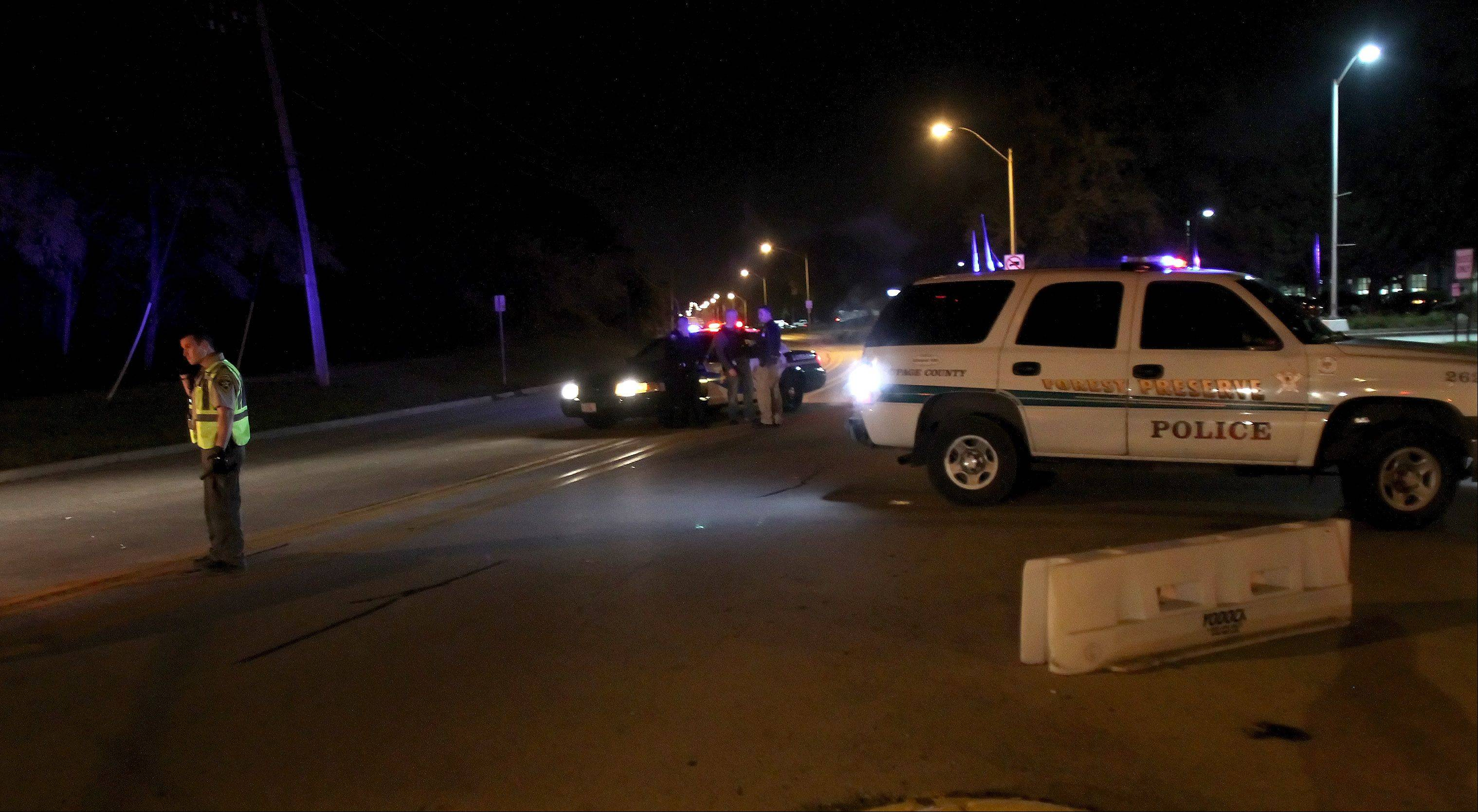 Police block off Lombard Avenue in Addison near Addison Trail High School Monday night after shots were fired a half-mile west of the school.