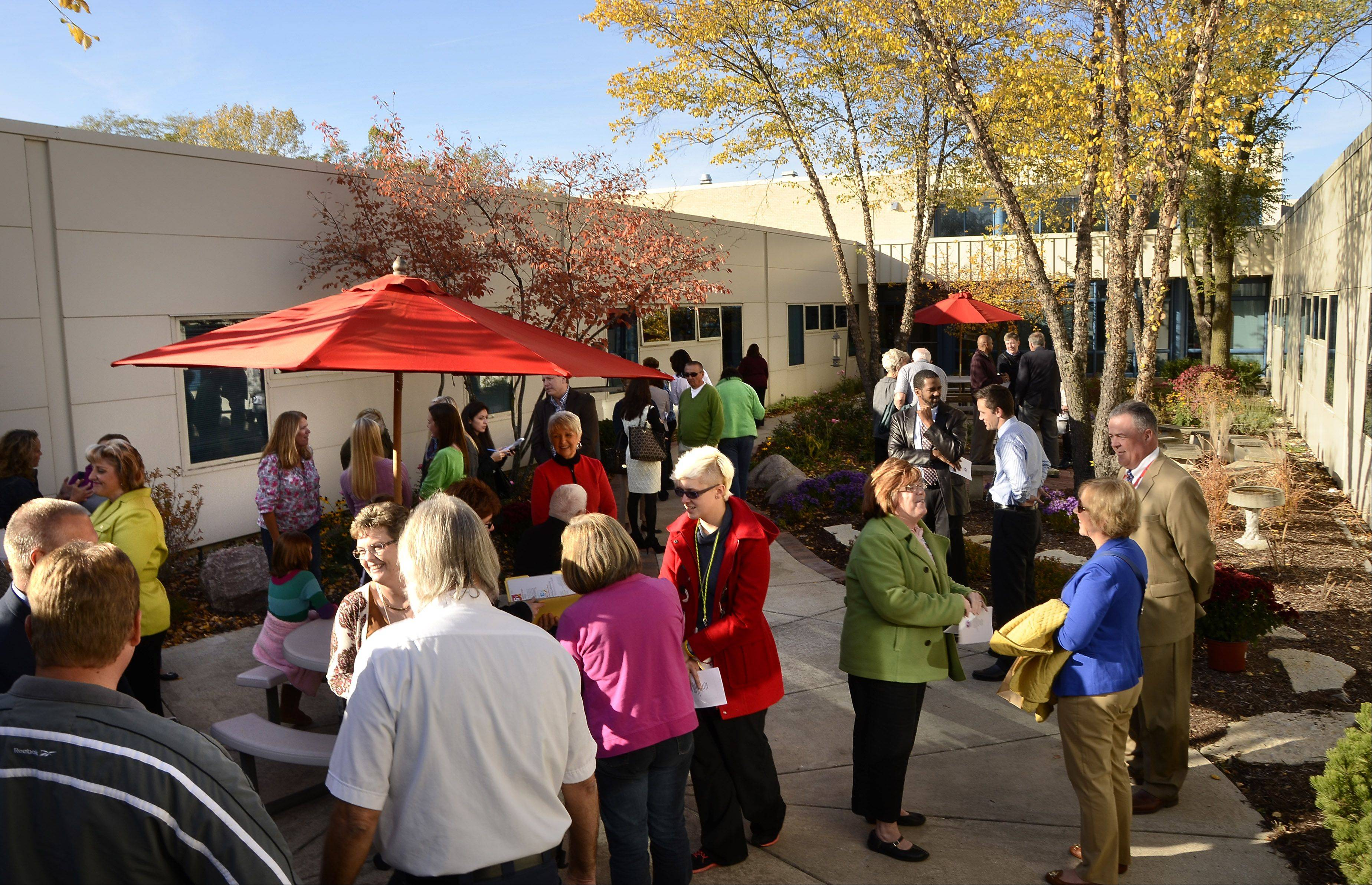 Family, friends and colleagues view the Dana Petersen Patio, dedicated in her memory Monday at Marion Jordan School in Palatine. Petersen, principal from 2001 to 2011, always wanted the school's courtyard to be an outdoor classroom. With donations from family and friends, her wish was granted.