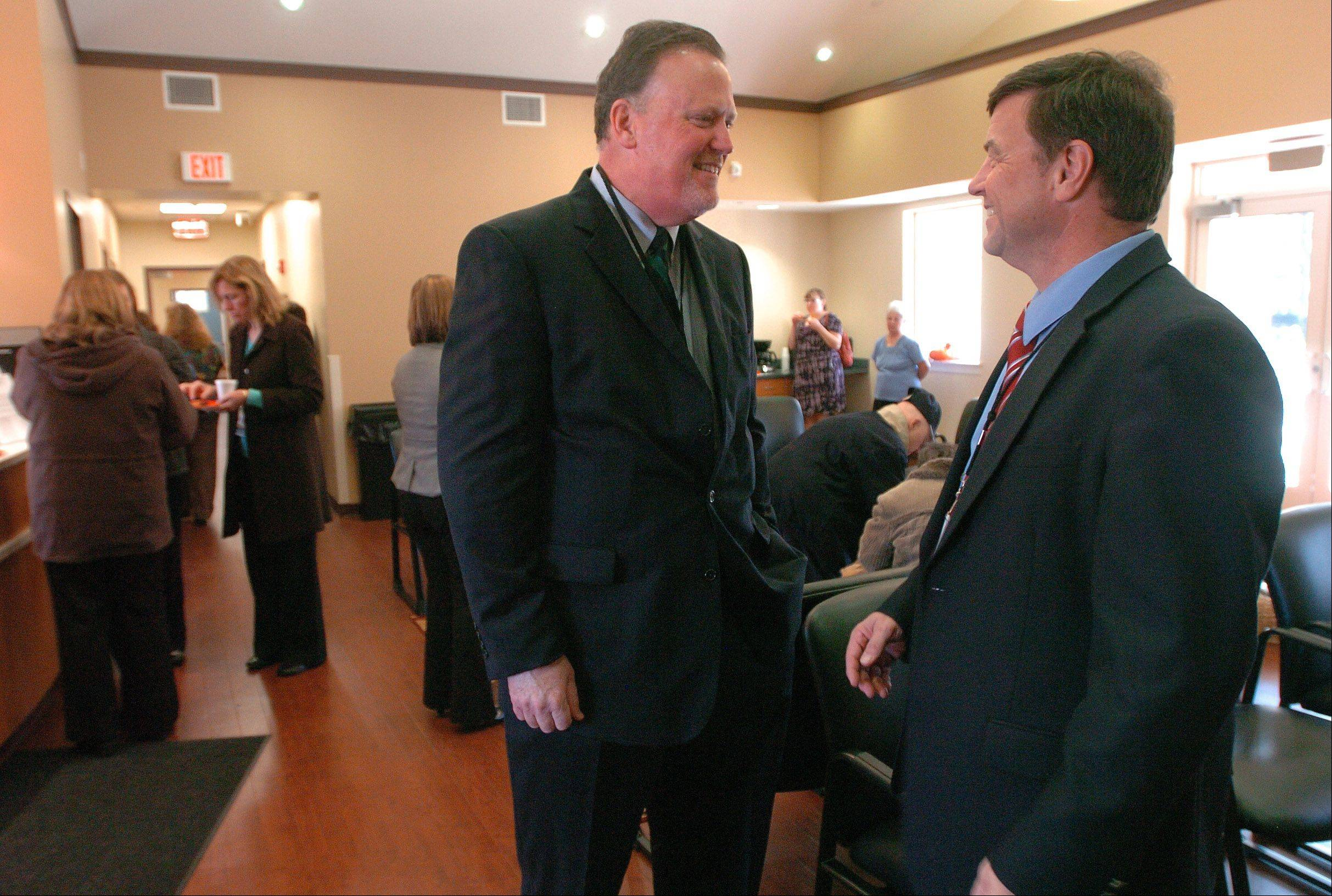 Brian J. Liedlich, vice president of development, Advocate Charitable Foundation, left, visits with Dr. Brian Chicoine.