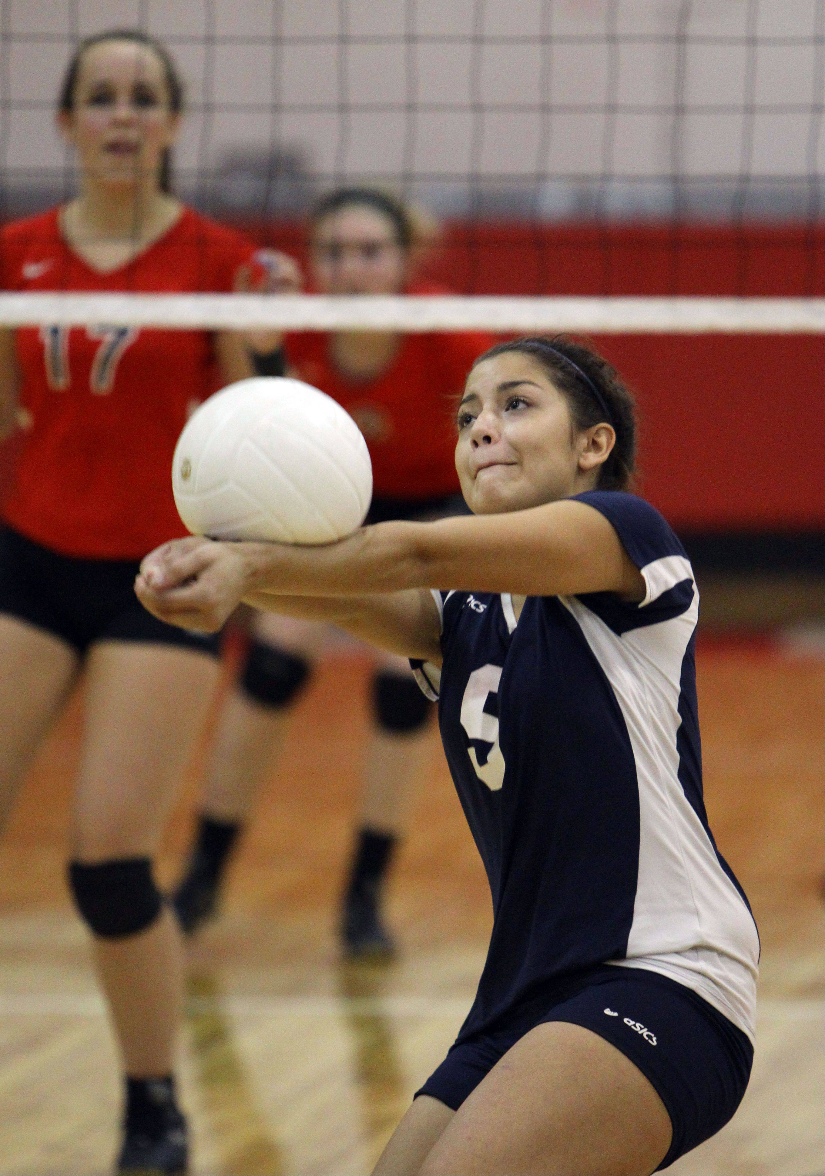 Round Lake's Melissa Mejia goes for the ball Monday night at Mundelein.
