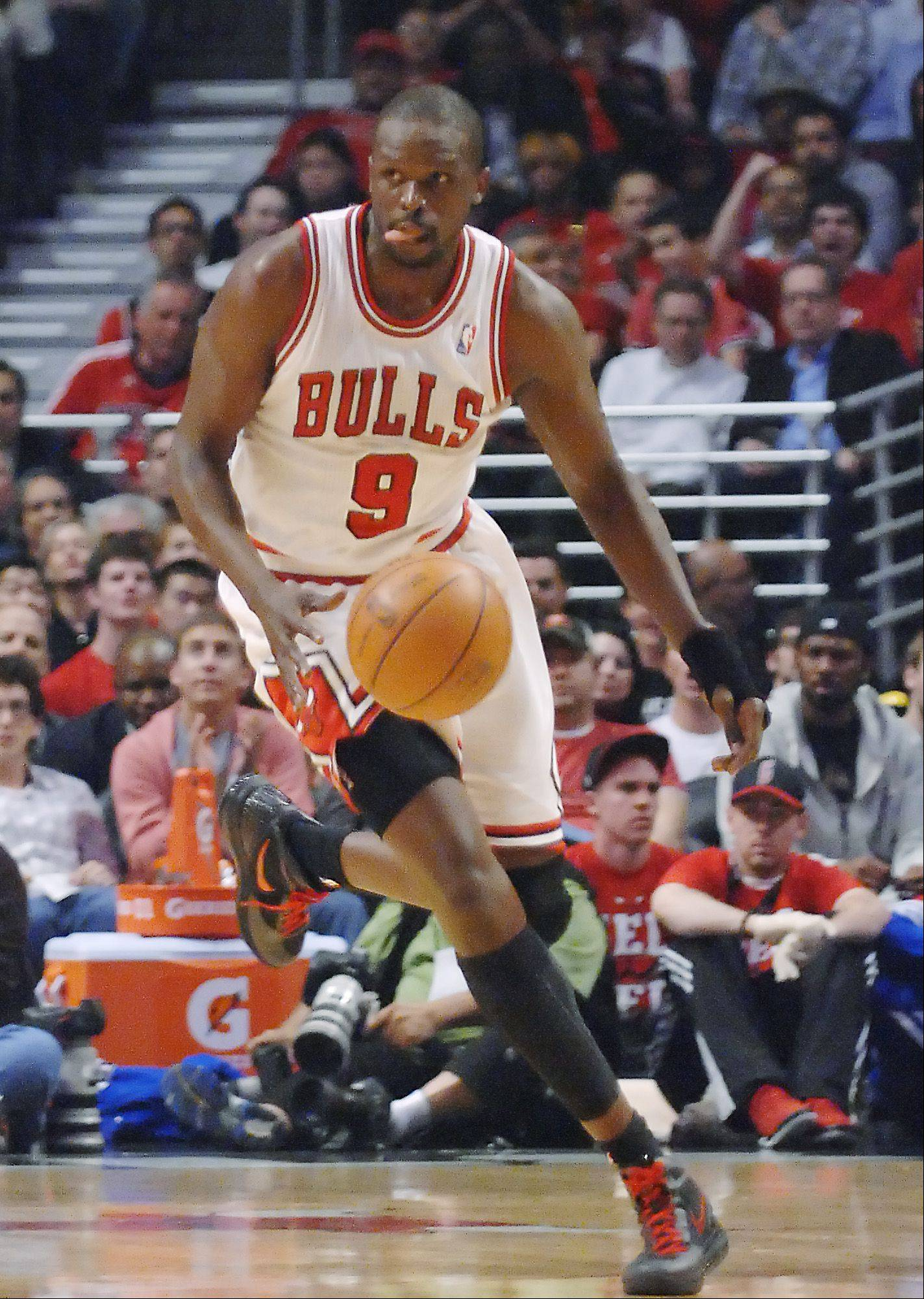 Bulls small forward Luol Deng looks for teammates as he drives up court Tuesday in the fifth game of the Eastern Conference first-round series at the United Center in Chicago.