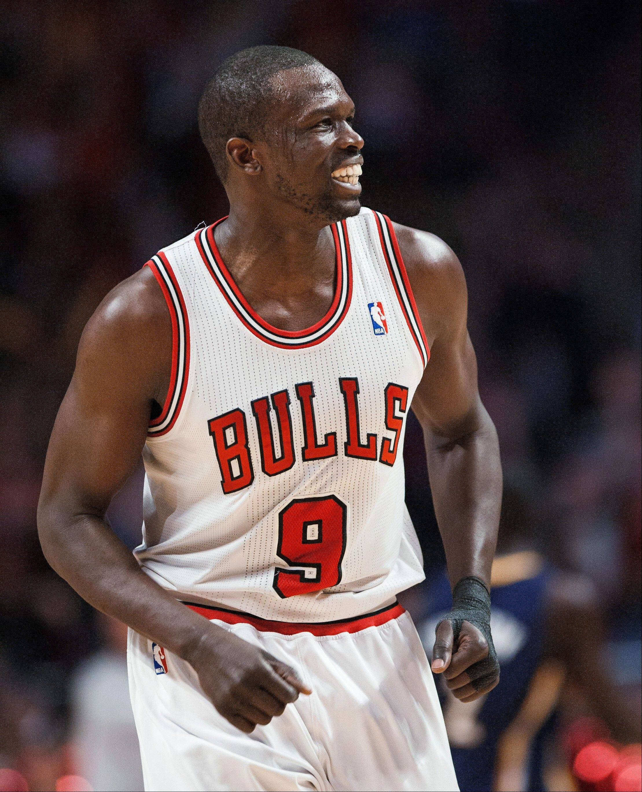 Bulls Luol Deng smiles after making a 3-pointer in the third quarter of the Bulls' 92-72 win over the Indiana Pacers.