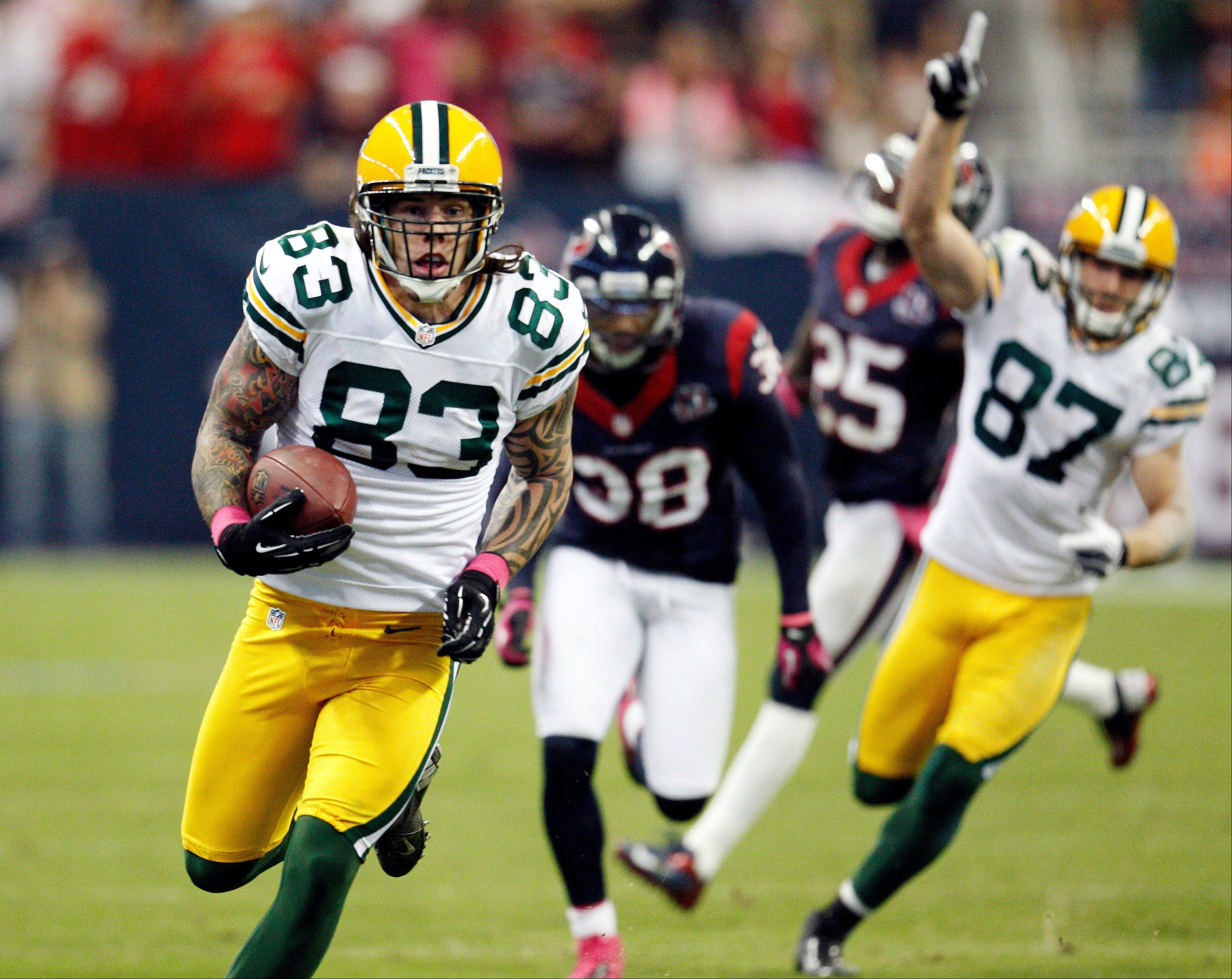 Green Bay Packers' Tom Crabtree makes a 48-yard touchdown reception against the Houston Texans during the fourth quarter Sunday in Houston. The Packers won 42-24.