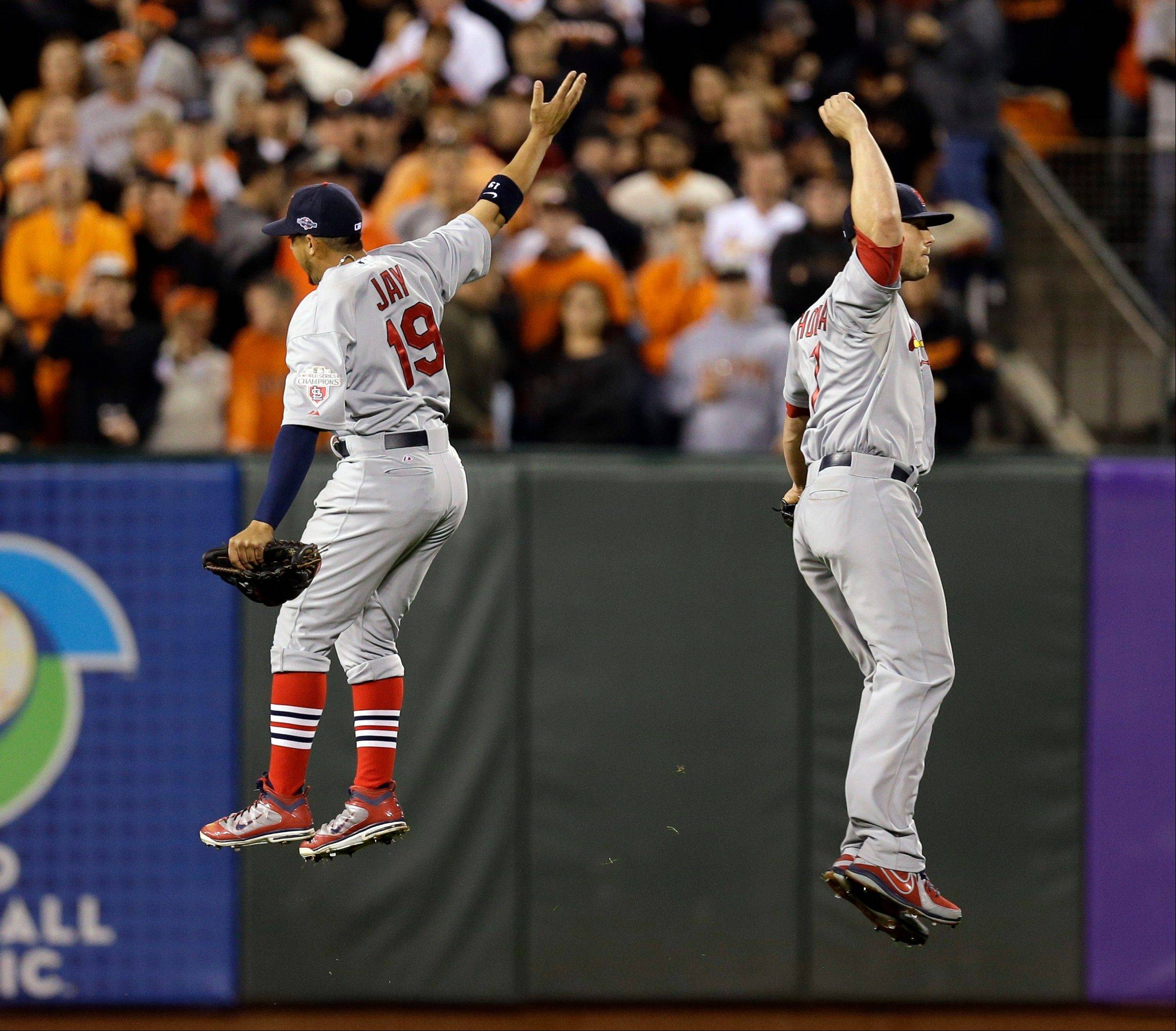St. Louis Cardinals' Jon Jay (19) and Matt Holliday celebrate after Game 1 of baseball's National League championship series against the San Francisco Giants Sunday in San Francisco. The Cardinals won 6-4.
