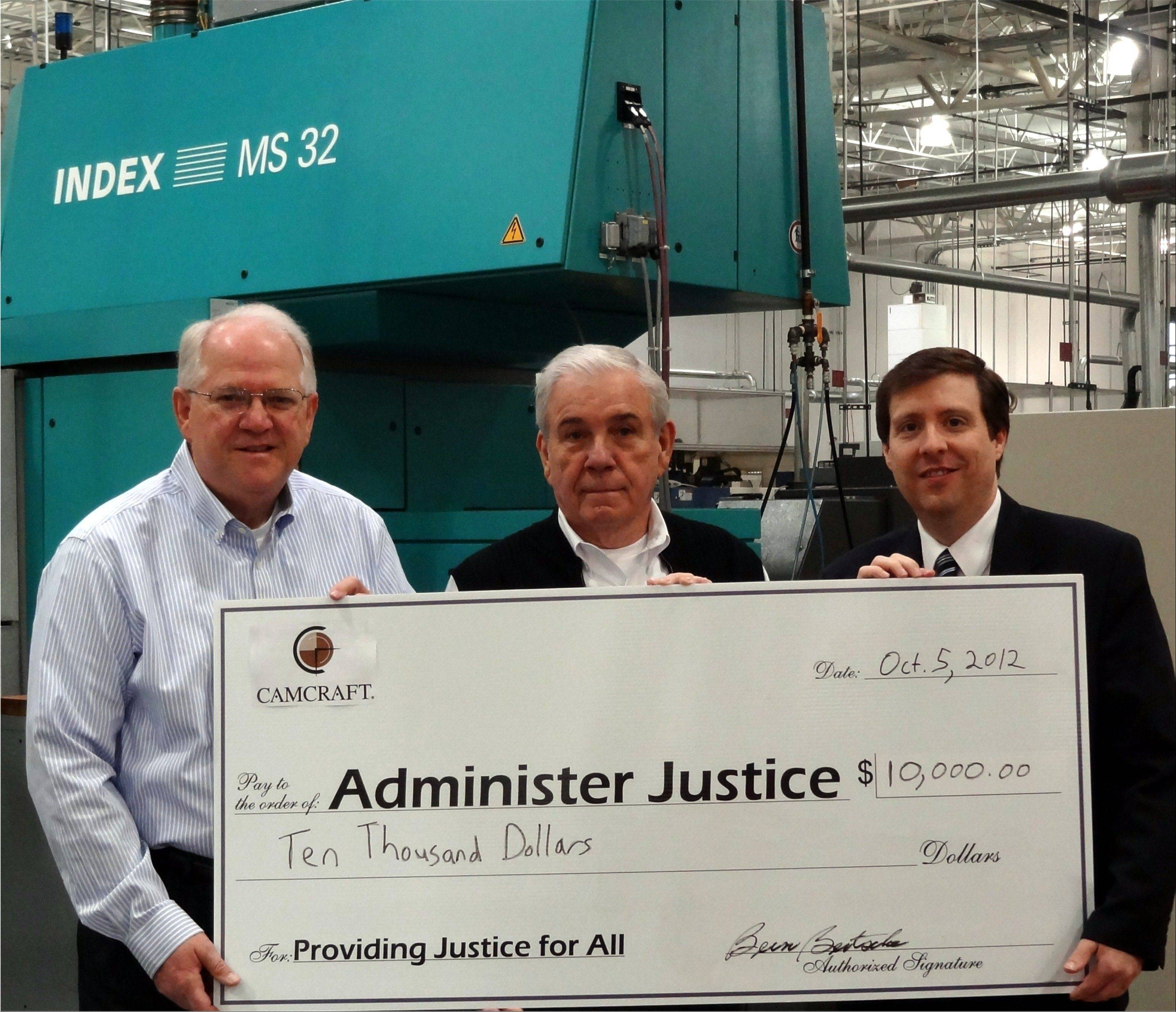 Camcraft owner and chairman Bern Bertsche, center, and John Walker, vice president of Human Resources, left, presented Administer Justice's executive director Bruce Strom with a check for $10,000 at the Camcraft facility in Hanover Park.