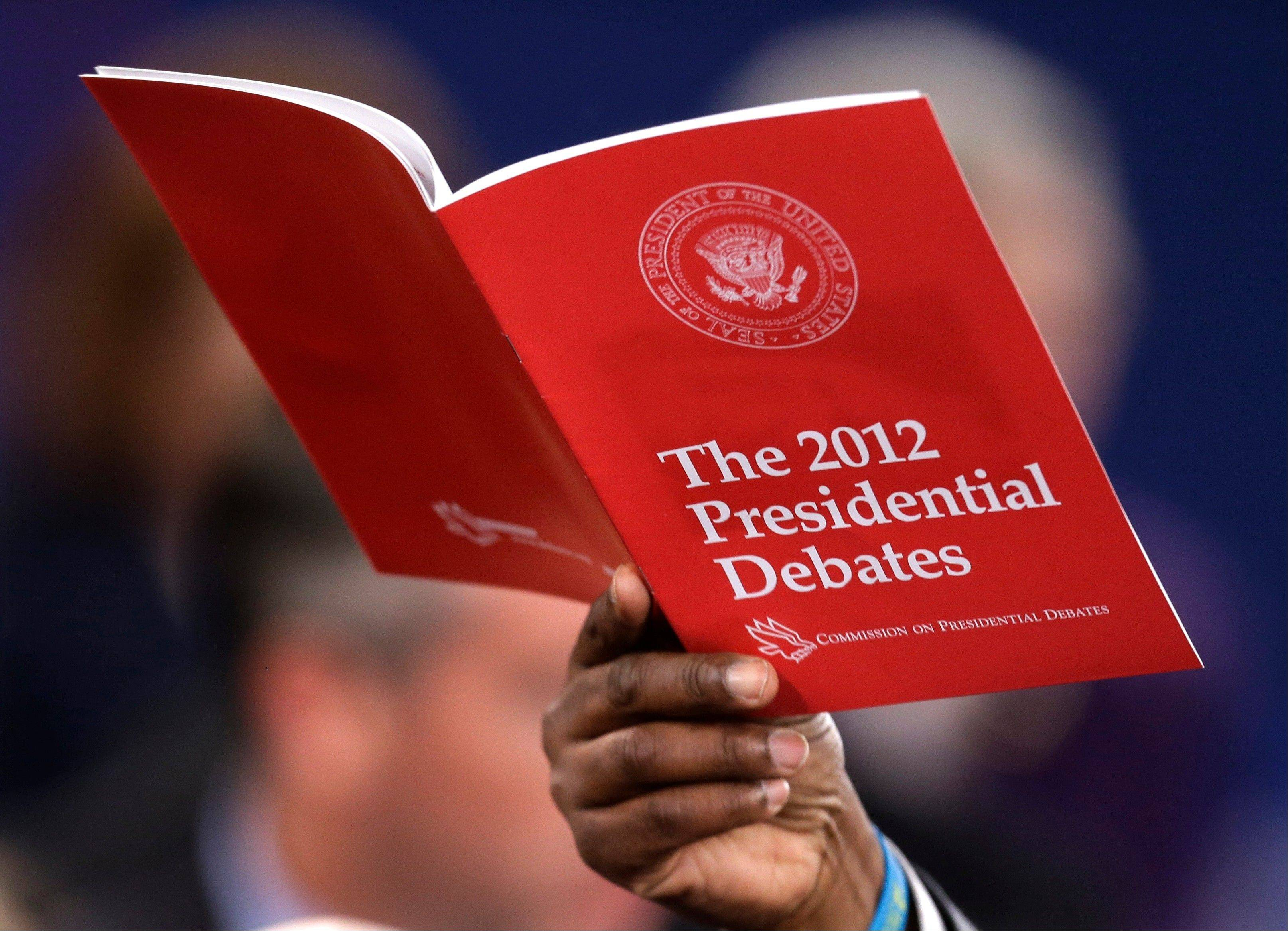A debate booklet is held up after the second presidential debate between President Barack Obama and Republican presidential nominee Mitt Romney at Hofstra University Tuesday in Hempstead, N.Y.