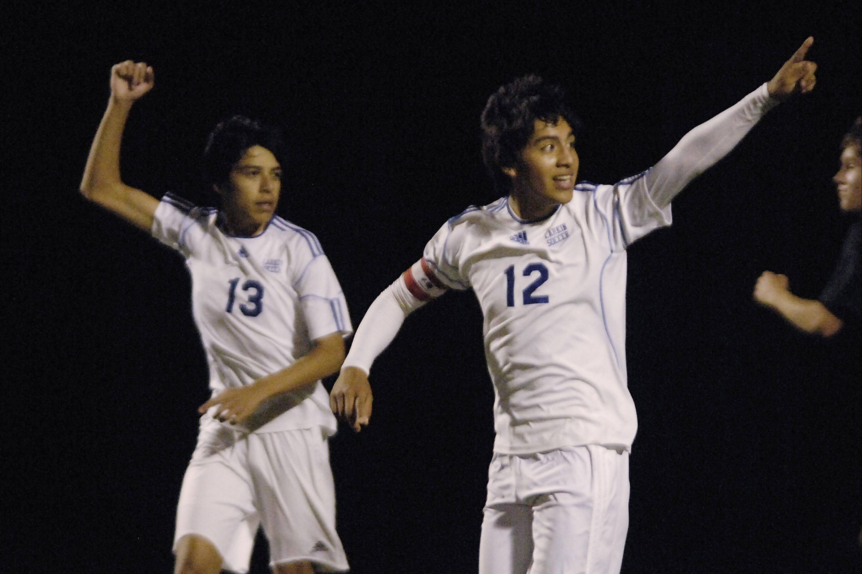 Larkin�s Hector Mendoza, left, and Tony Hernandez celebrate Mendoza�s first-half goal against York on Tuesday in the Schaumburg regional. Both players scored in the 3-1 Royals win.