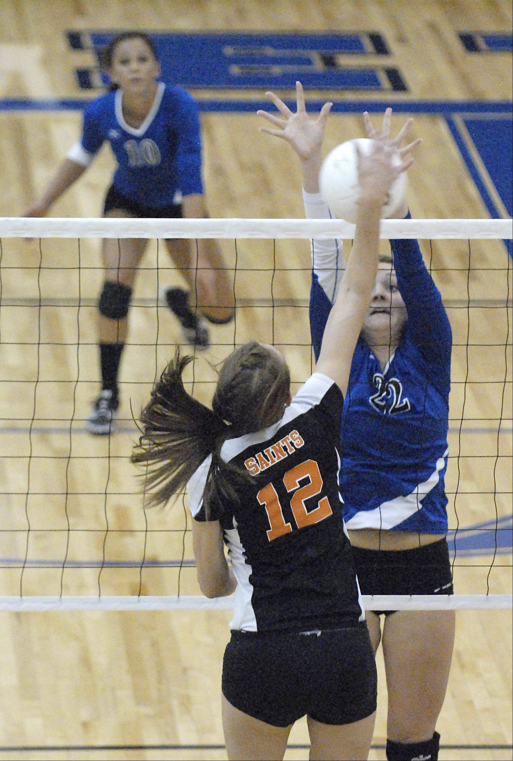 Laura Stoecker/lstoecker@dailyherald.com Geneva's Maddie Courter attempts to stop a spike by St. Charles East's Ashley Bullock in game one on Tuesday, October 16.