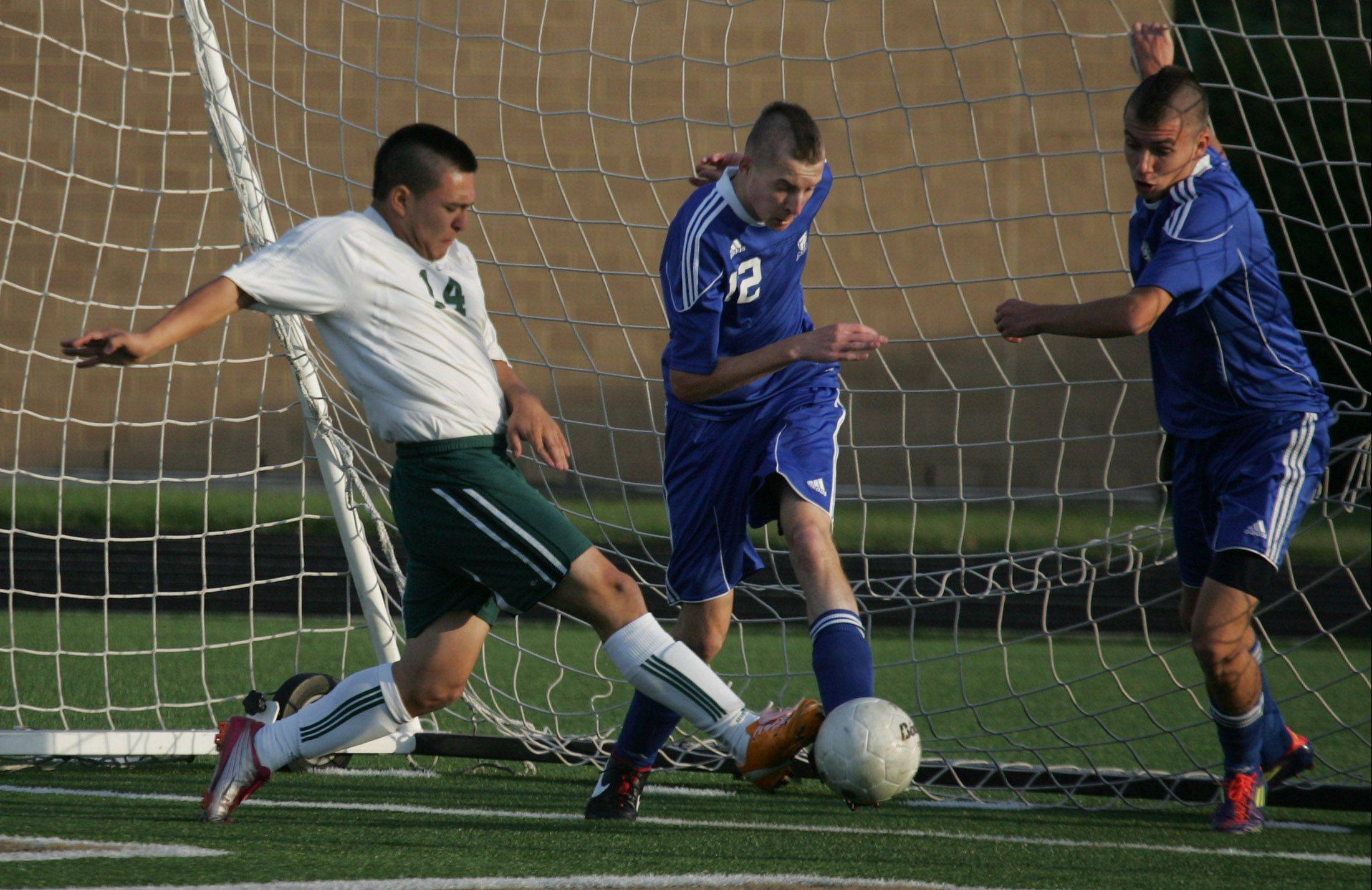 Stevenson�s Ceasar Navarro scores the first goal of the game between Lake Zurich�s James Blasko and Kevin Loch during Class 3A boys regional semifinal play Tuesday in Lincolnshire.