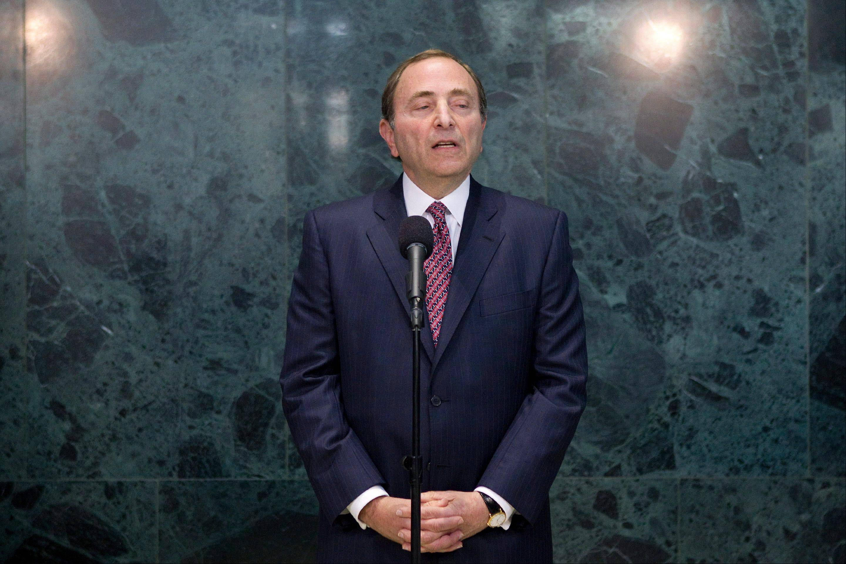 NHL commissioner Gary Bettman speaks to reporters Tuesday following collective bargaining talks in Toronto.