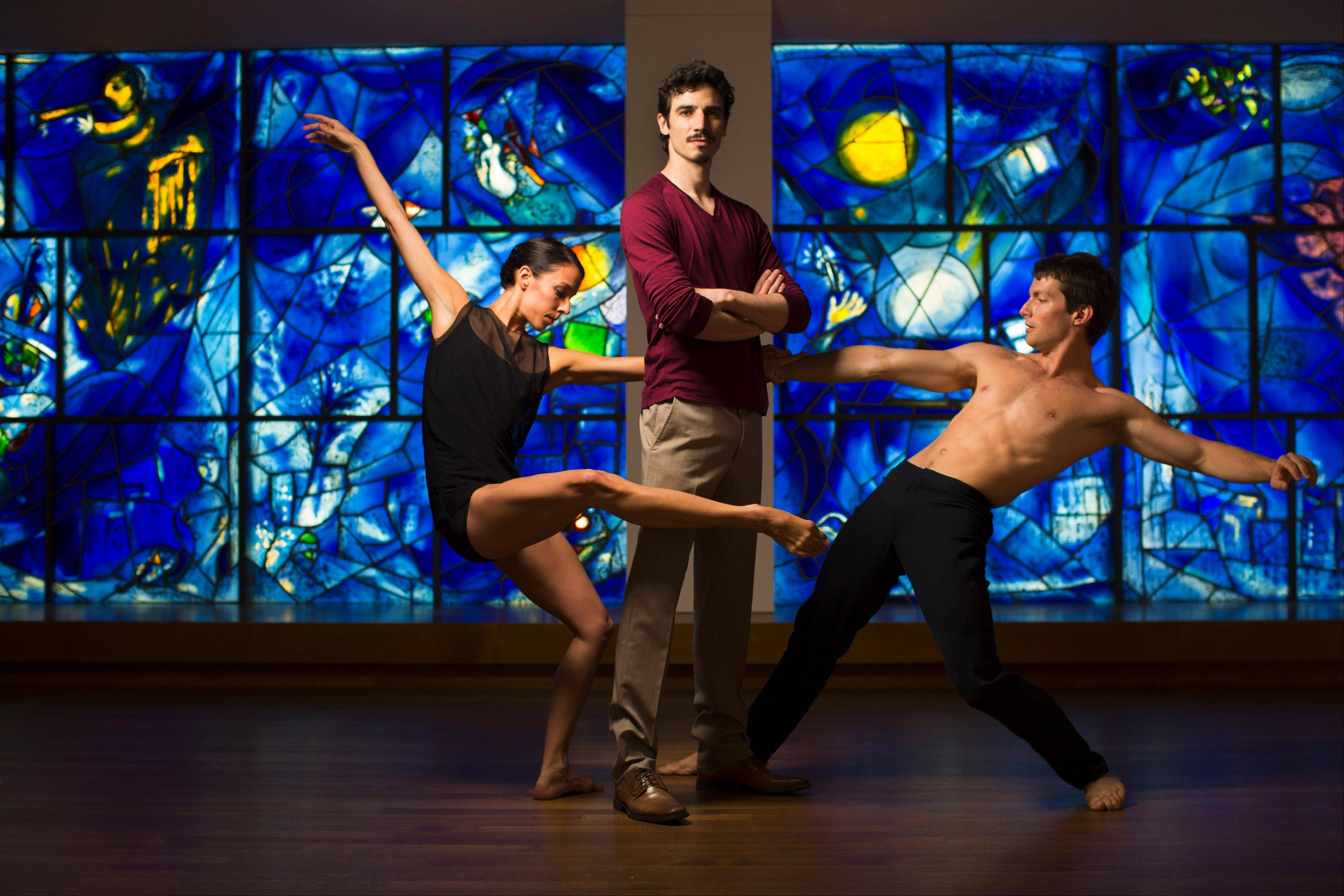 "Hubbard Street Dance Chicago's Anna Lopez and Garrett Anderson encircle choreographer Alejandro Cerrudo in front of Marc Chagall's America Windows at the Art Institute of Chicago. The stained glass artwork inspired Cerrudo to create the dance work ""One Thousand Pieces."""