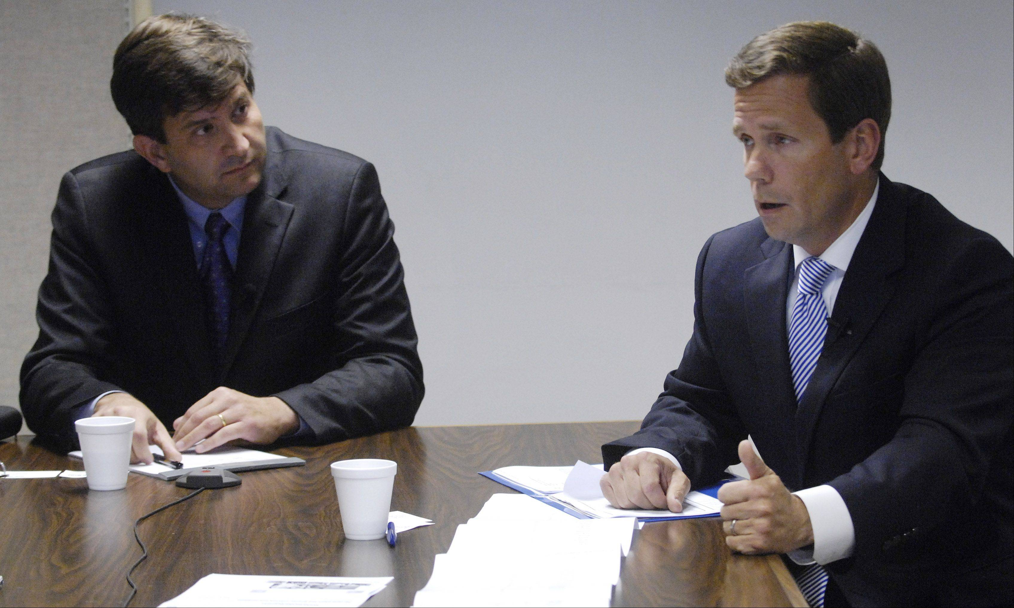 Democratic challenger Brad Schneider, left, and Republican U.S. Rep. Robert Dold, right, recently met with reporters and editors at the Daily Herald to talk about the issues in the 10th District race.